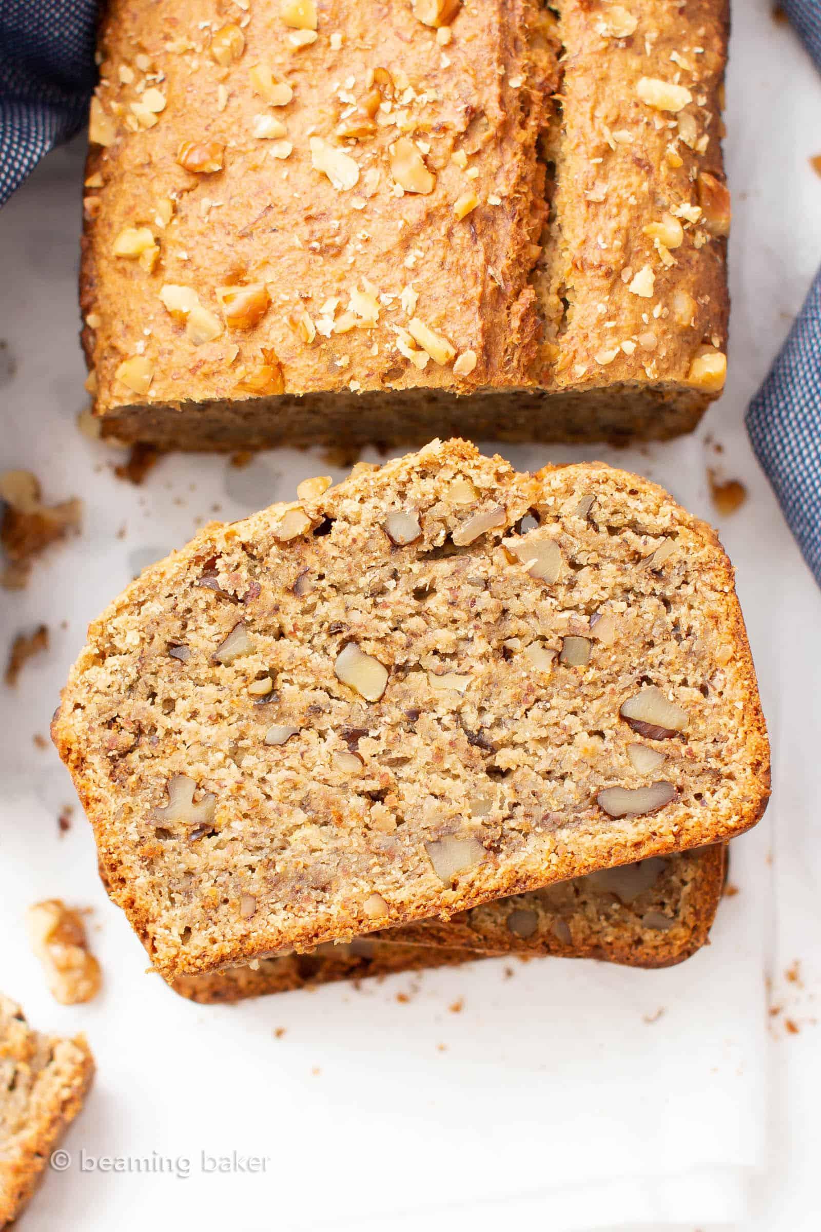Vegan Gluten Free Banana Bread (GF): an amazing 1-bowl vegan gluten free banana bread recipe that yields perfectly moist banana bread bursting with banana flavor! Vegan, Gluten Free. #VeganGlutenFree #BananaBread #GlutenFreeVegan #Banana #VGF | Recipe at BeamingBaker.com