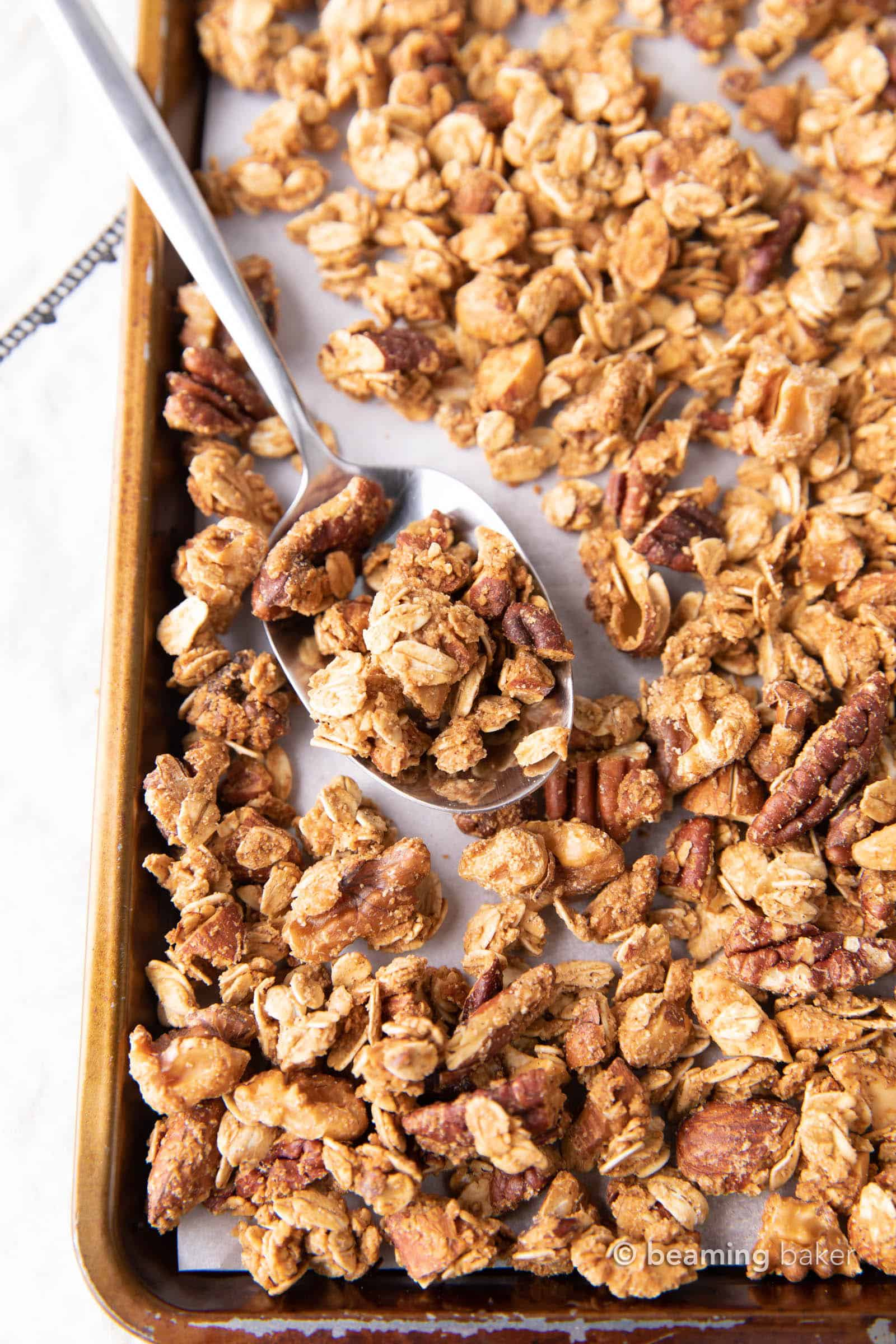 Gluten Free Granola: this 4 ingredient vegan granola recipe is prep'd in 5 minutes! The best GF granola: crunchy clusters, healthy ingredients & great flavor! #GlutenFree #Granola #Vegan #GF | Recipe at BeamingBaker.com