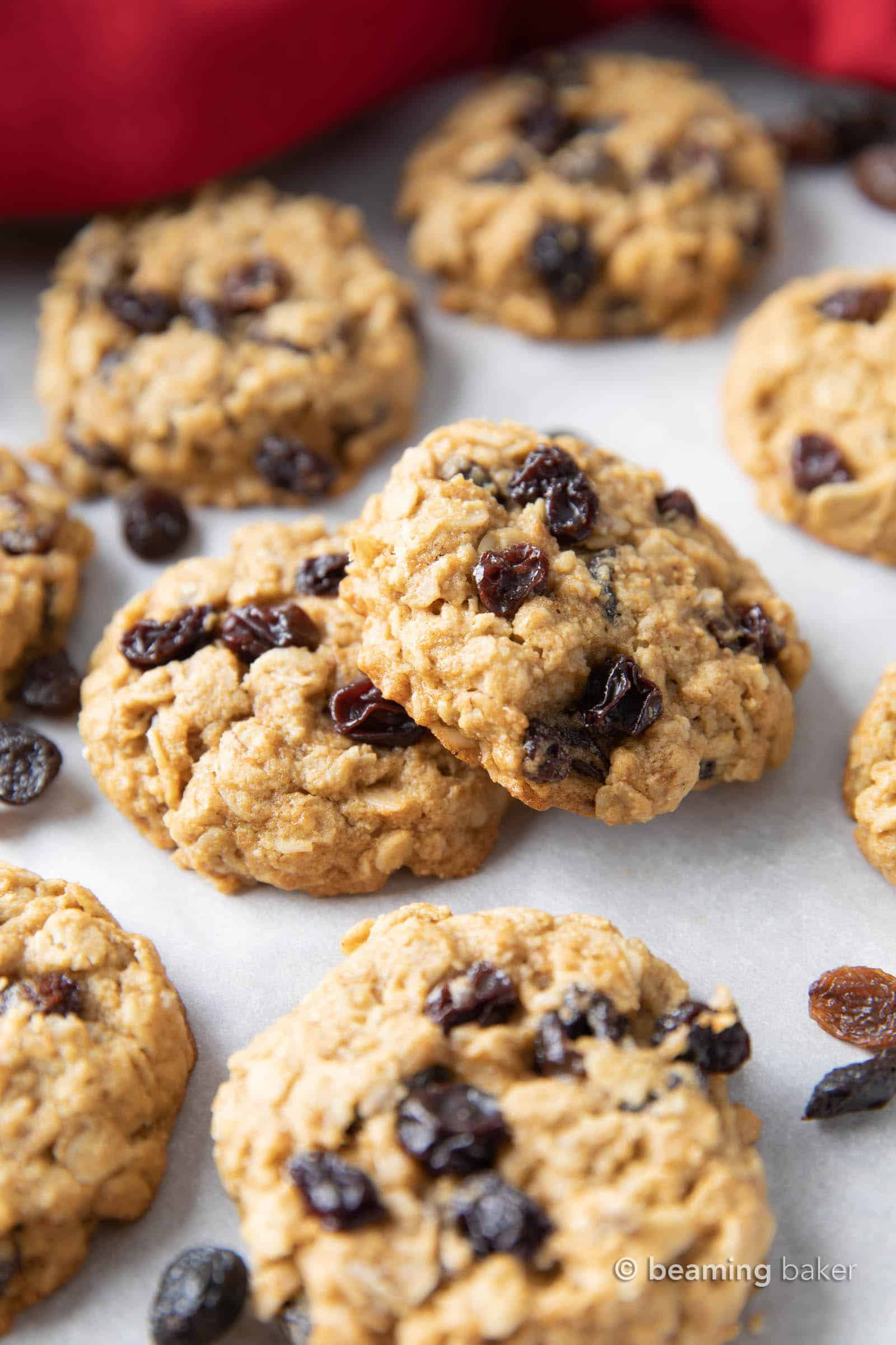 Easy Gluten Free Vegan Oatmeal Raisin Cookies (Vegan): this gluten free oatmeal raisin cookies recipe yields soft & buttery oatmeal cookies bursting with juicy raisins. Refined Sugar-Free. #OatmealRaisin #GlutenFree #Vegan #Cookies | Recipe at BeamingBaker.com