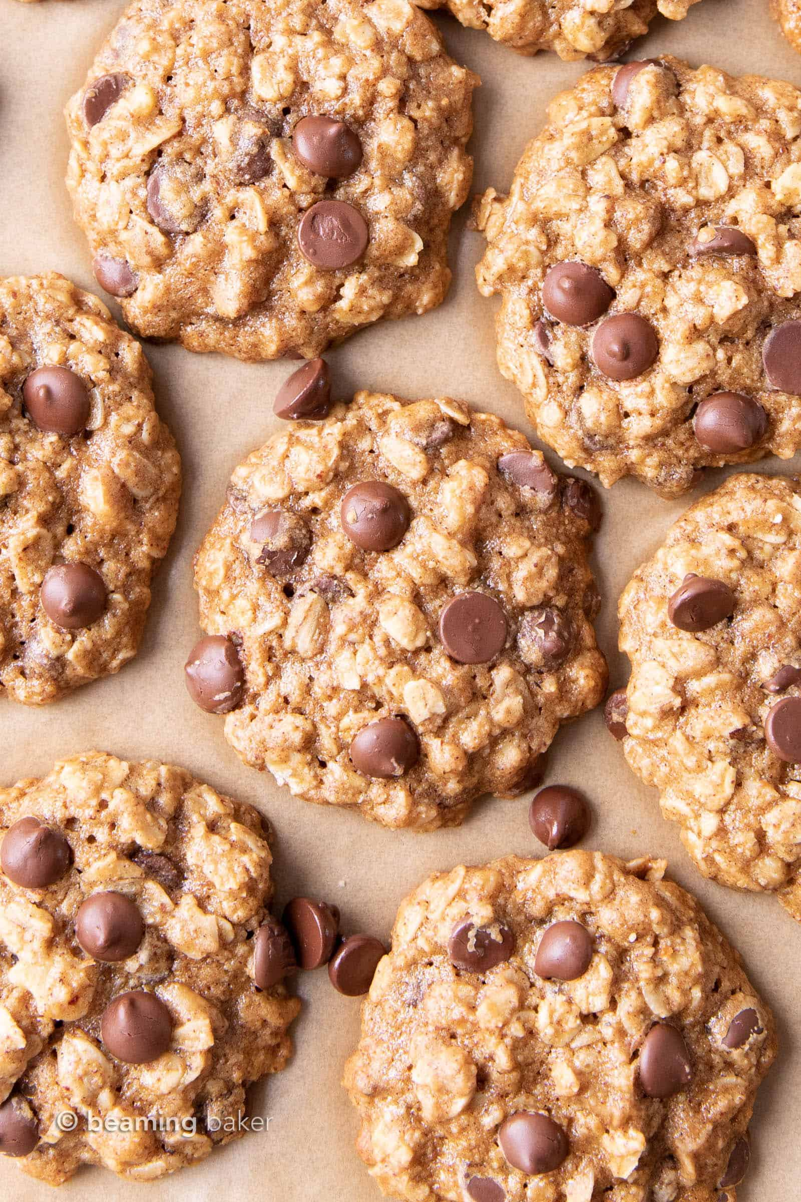Easy Healthy Oatmeal Chocolate Chip Cookies: this easy healthy oatmeal chocolate chip cookies recipe yields chewy cookies with crispy edges and lots of chocolate chips! Vegan, Gluten-Free, Dairy-Free, Healthy. #Healthy #OatmealCookies #HealthyCookies #ChocolateChip   Recipe at BeamingBaker.com