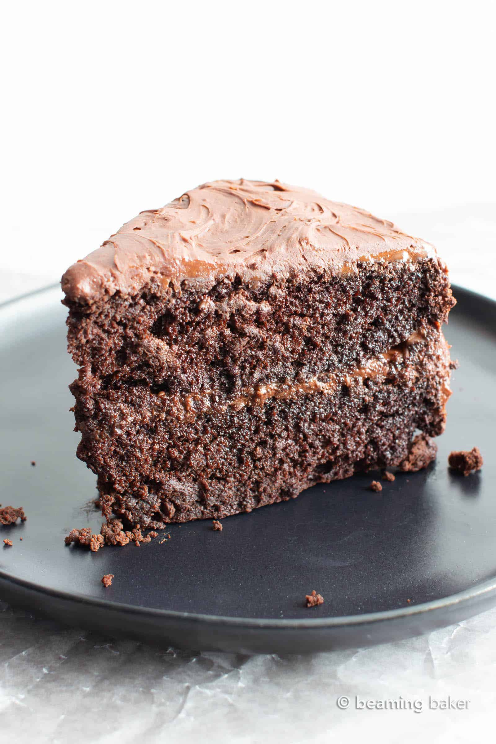 Vegan Gluten Free Chocolate Cake Recipe: this gluten free dairy free cake yields moist & rich chocolate cake covered in irresistible creamy chocolate frosting! My favorite vegan gluten free cake recipe! #GlutenFree #Vegan #Cake #Chocolate #DairyFree | Recipe at BeamingBaker.com