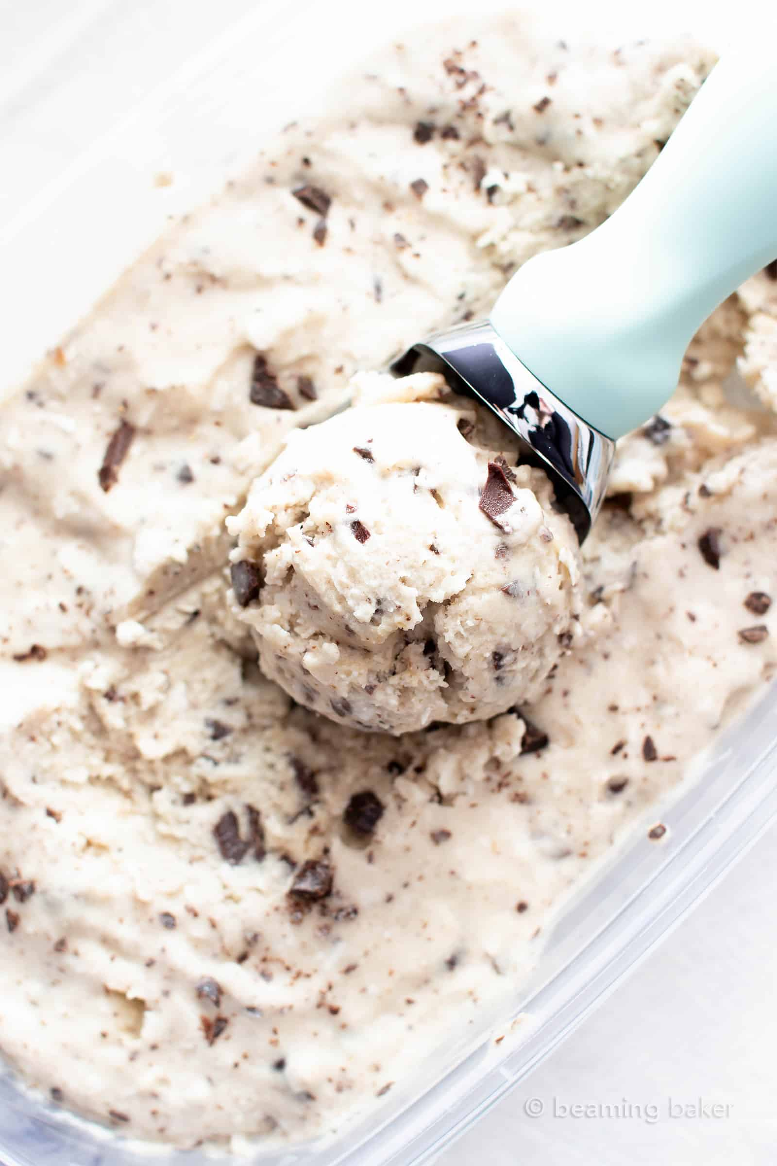 Coconut Chocolate Chip Vegan Ice Cream Recipe: this delicious vegan ice cream recipe is wonderfully rich 'n creamy! The best homemade vegan ice cream—packed with coconut & chocolate chips, no churn. #Vegan #IceCream #Coconut #ChocolateChip #VeganIceCream | Recipe at BeamingBaker.com