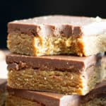 No Bake Paleo Chocolate Almond Butter Bars: this easy paleo dessert recipe yields deliciously thick no bake almond butter bars topped with velvety paleo chocolate. It's the best quick & simple paleo sweets recipe! #Paleo #NoBake #Dessert #Vegan #Treats | Recipe at BeamingBaker.com