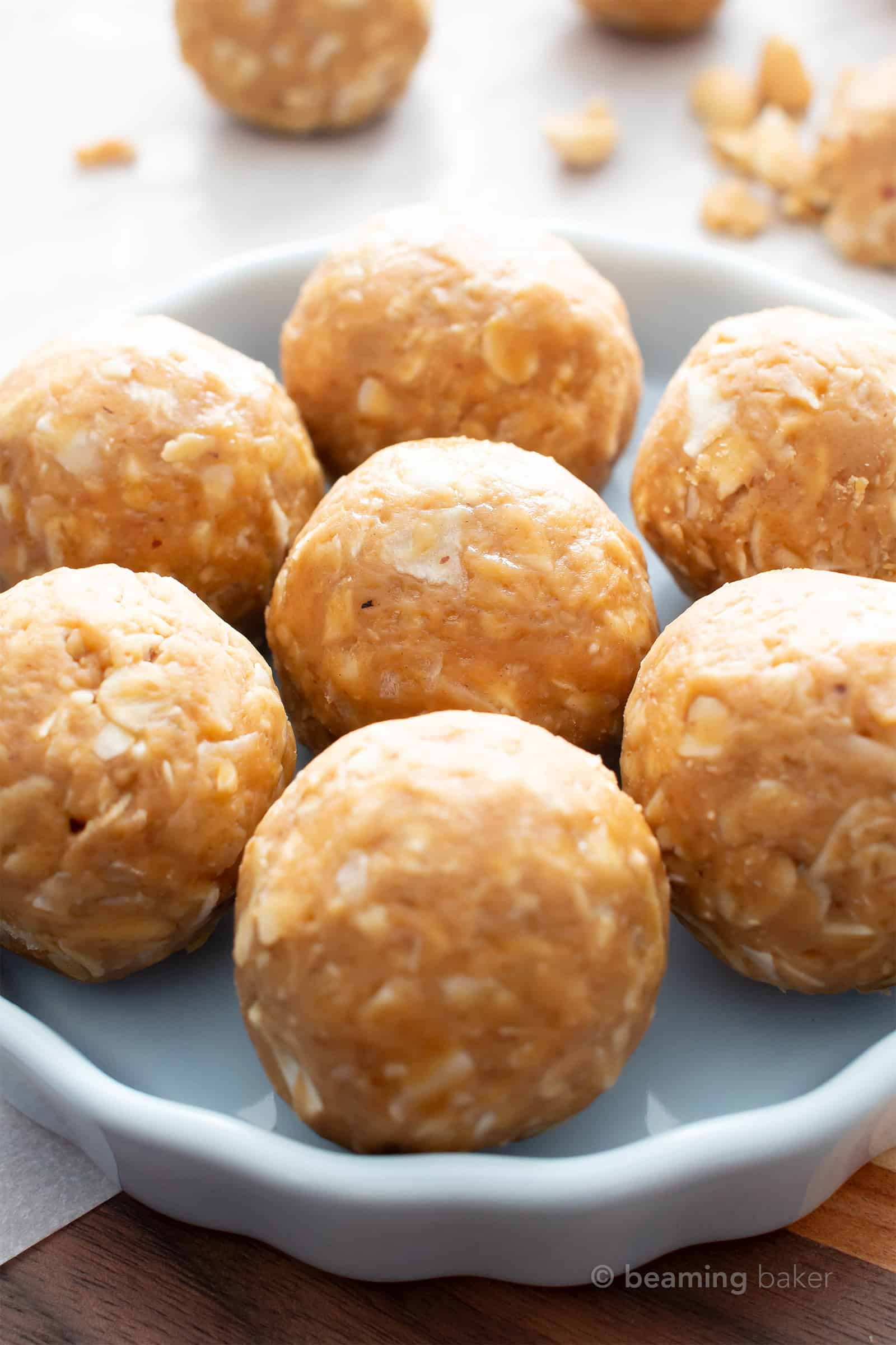 No Bake Peanut Butter Coconut Balls: this healthy energy bites recipe yields chewy, sweet 'n nutty vegan protein balls with just 6 ingredients! Easy, Gluten Free, Protein Balls! #PeanutButter #Coconut #Healthy #Vegan #GlutenFree | Recipe at BeamingBaker.com