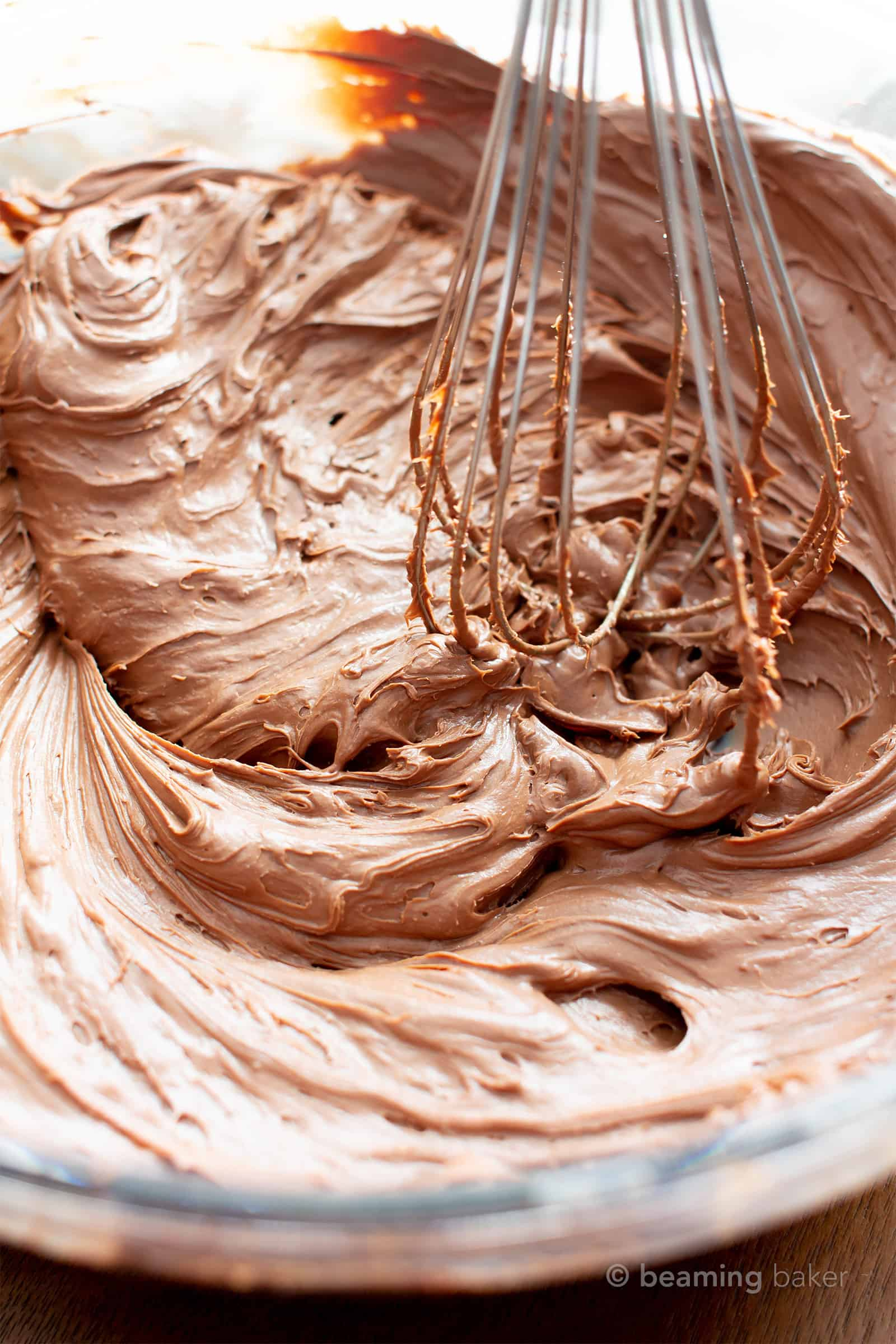Vegan Chocolate Frosting Recipe: a smooth, silky & creamy dairy free frosting recipe—healthy, refined sugar-free! This paleo chocolate frosting is so easy, with 2 ingredients: coconut cream and chocolate, perfect for frosting chocolate cake & cupcakes! #Vegan #Paleo #GlutenFree #DairyFree #Frosting | Recipe at BeamingBaker.com