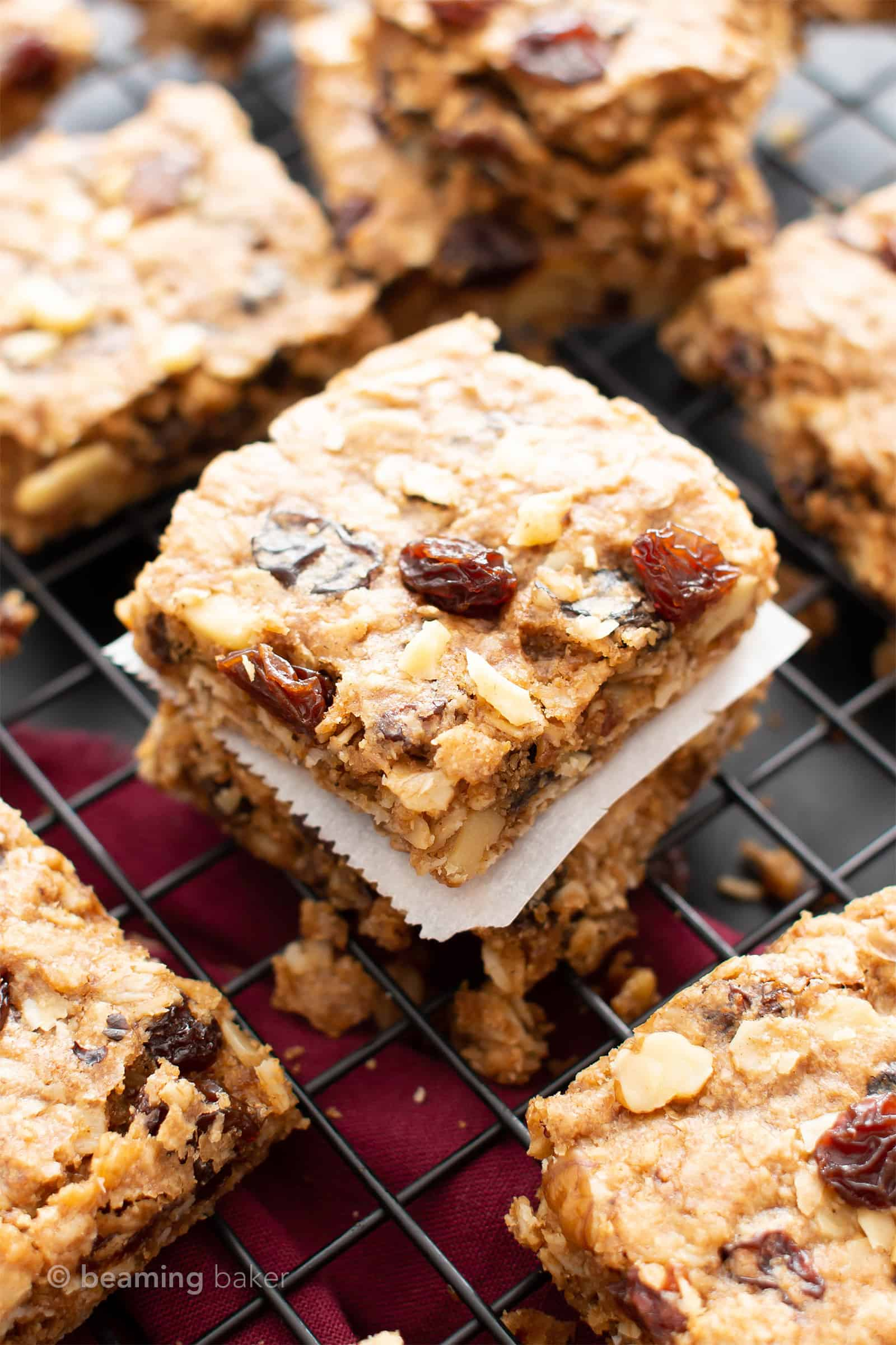 The BEST Vegan Oatmeal Raisin Bars Recipe: chewy centers, crispy edges, packed with raisins & oats! The ultimate gluten free oatmeal cookie bars—healthy, homemade & easy! #Oatmeal #Vegan #GlutenFree #Cookies | Recipe at BeamingBaker.com