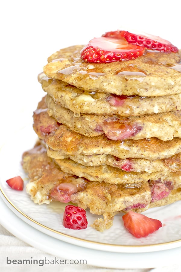 beamingbaker.com An easy recipe for the BEST fluffy strawberry white chocolate chip pancakes! Made with simple ingredients: oat flour, almond meal, whole wheat flour and coconut.