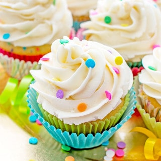 Funfetti Birthday Cupcakes: Moist, classic white cupcakes speckled with funfetti sprinkles and topped with luscious, fluffy vanilla frosting. BEAMINGBAKER.COM #birthday #cupcakes