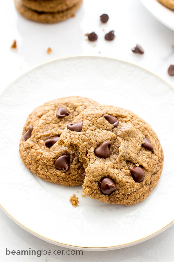 Soft, chewy, crispy on the bottom Healthier Vegan Chocolate Chip Cookies. Made with oat flour, whole wheat flour, organic unrefined coconut sugar and coconut oil. BEAMINGBAKER.COM #VEGAN