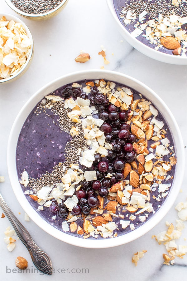 Blueberry Coconut Smoothie Bowls (V+GF): An easy recipe for a refreshing smoothie bowl packed with antioxidants, blueberries and coconut. BEAMINGBAKER.COM #Vegan #GlutenFree