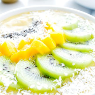 Mango Kiwi Chia Seed Smoothie Bowl (V+GF): a super easy recipe for a light, refreshing and filling smoothie bowl full of mangoes and topped with kiwis. #Vegan #GlutenFree | BeamingBaker.com