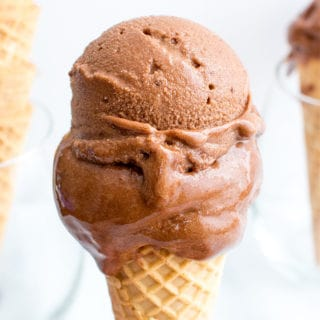 Dark Chocolate Nice Cream (V+GF): an easy, 4 ingredient recipe for velvety smooth, rich dark chocolate nice cream made of bananas, cocoa powder and maple syrup. #Vegan #GlutenFree #DairyFree | BeamingBaker.com