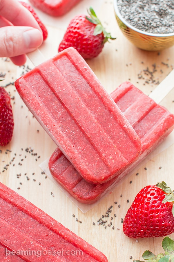 Vegan Strawberry Chia Seed Popsicles (V+GF): a 3 ingredient recipe for delicious, refreshing strawberry popsicles bursting with chia seeds. #Vegan #DairyFree #GlutenFree | BeamingBaker.com
