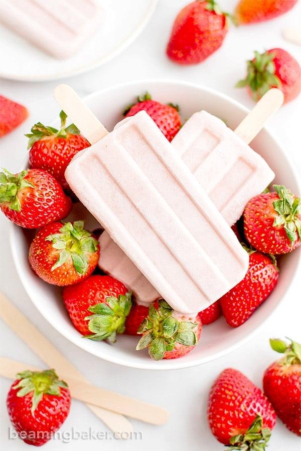 Vegan Strawberry Coconut Popsicles (V, GF, DF): a 4 ingredient, plant-based recipe for creamy, refreshing popsicles bursting with strawberry and coconut flavor. #Vegan #DairyFree #Paleo #GlutenFree   BeamingBaker.com