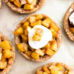 No Bake Caramel Apple Tartlets (V+GF): a whole ingredient recipe for mini caramel pecan tarts bursting with sweet apple flavor. #Vegan #GlutenFree #DairyFree | BeamingBaker.com | @BeamingBaker