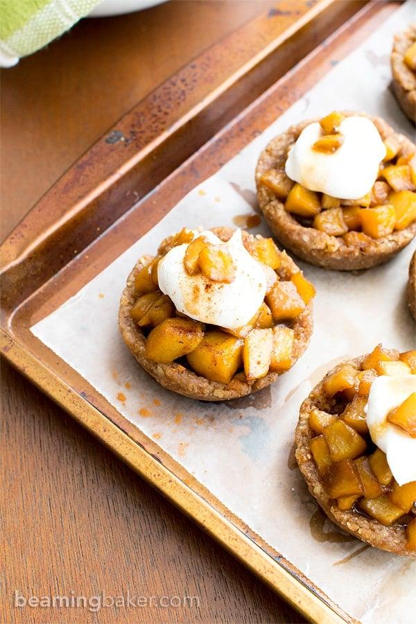 No Bake Caramel Apple Tartlets (V+GF): a whole ingredient recipe for mini caramel pecan tarts bursting with sweet apple flavor. #Vegan #GlutenFree #DairyFree   BeamingBaker.com   @BeamingBaker