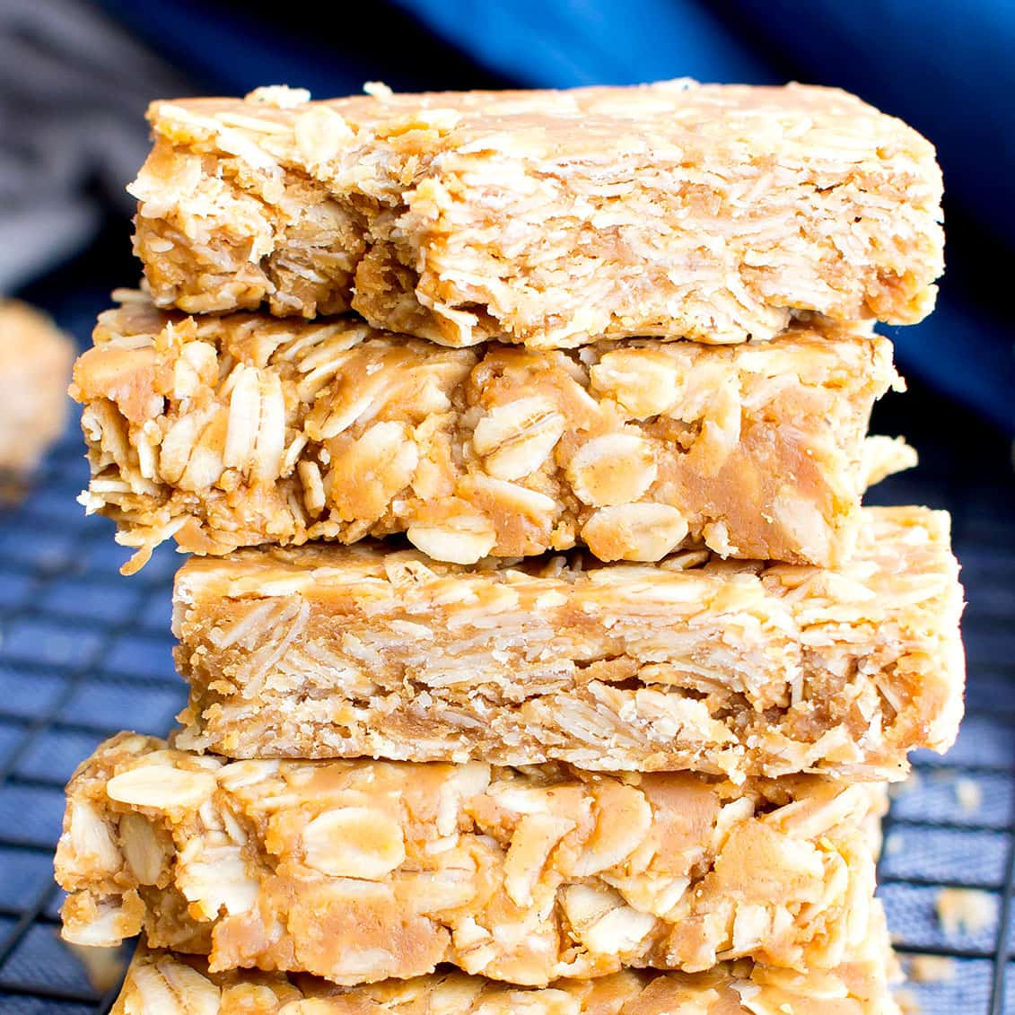 3 Ingredient No Bake Peanut Butter Granola Bars (GF): this homemade peanut butter granola bars recipe so EASY! The best oatmeal peanut butter granola bars recipe without honey, that taste like honey roasted peanuts. Healthy, Vegan, Gluten Free. #PeanutButter #GranolaBars #NoBake #Oatmeal | Recipe at BeamingBaker.com