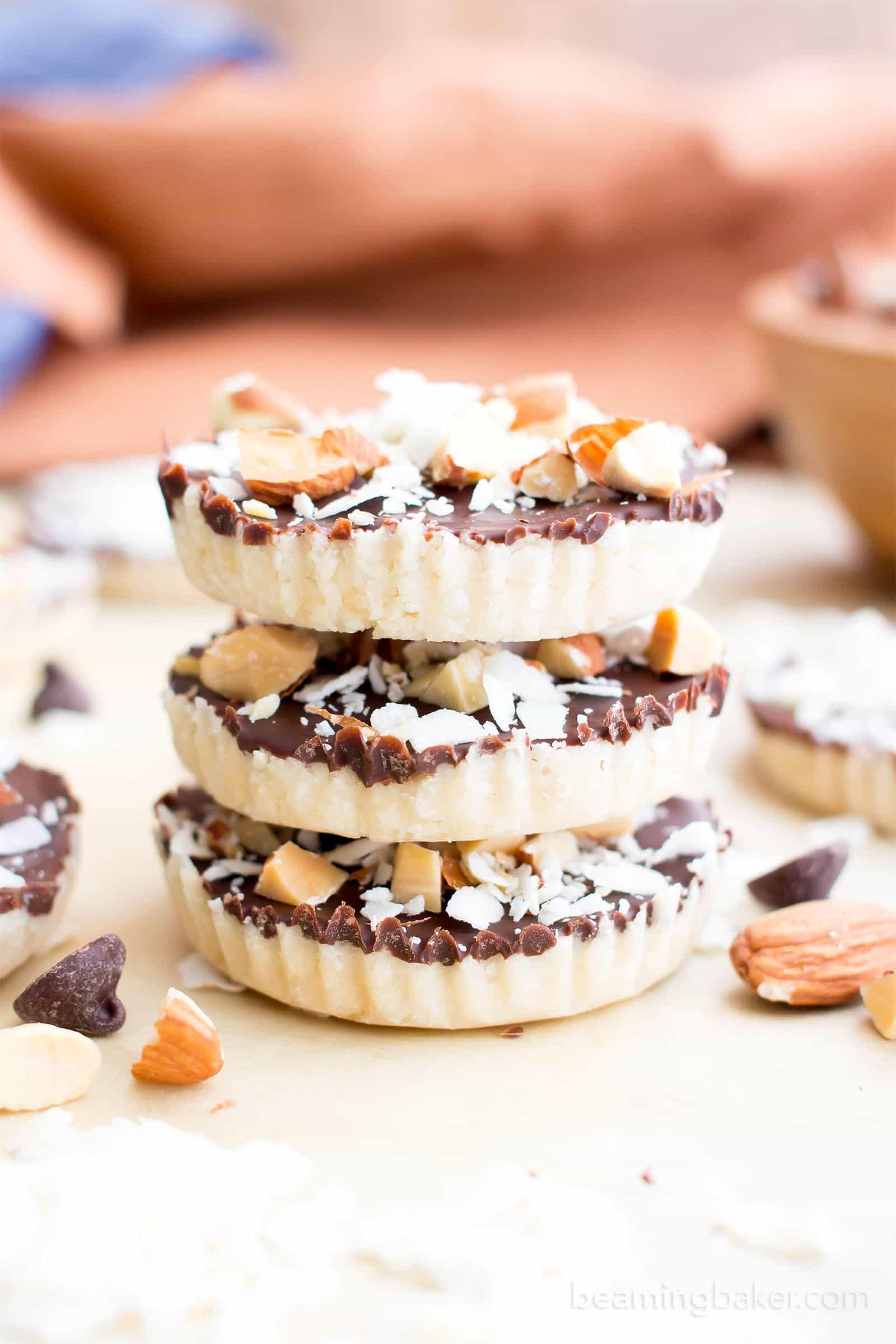 Homemade Almond Joy Cups (Paleo, V, GF): a 5-ingredient recipe for rich, nutty Almond Joy cups layered in velvety chocolate. #Paleo #Vegan #GlutenFree #5Ingredient   BeamingBaker.com