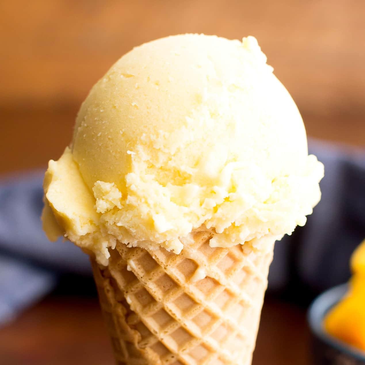 Homemade Mango Ice Cream: this 3 ingredient mango ice cream recipe is super EASY! 5 mins of prep for the best mango ice cream: rich & creamy with big mango flavor! Vegan, Dairy-Free, Healthy. #Mango #IceCream #Vegan #DairyFree | Recipe at BeamingBaker.com