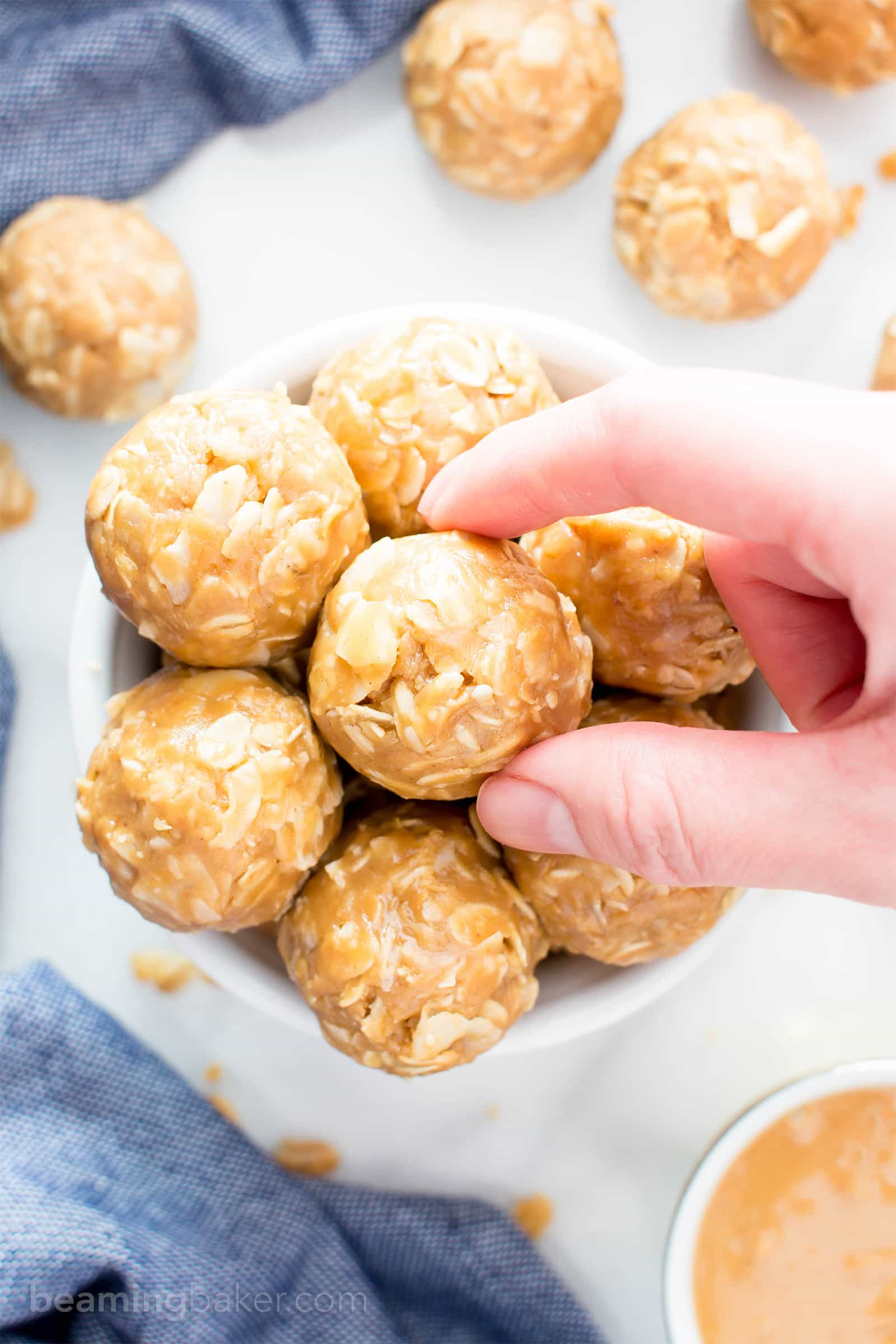 4 Ingredient No Bake Peanut Butter Coconut Energy Bites (V, GF): a quick 'n easy One Bowl recipe for tasty protein-packed energy bites bursting with peanut butter and coconut! #Vegan #ProteinRich #GlutenFree #DairyFree #WholeGrain   BeamingBaker.com