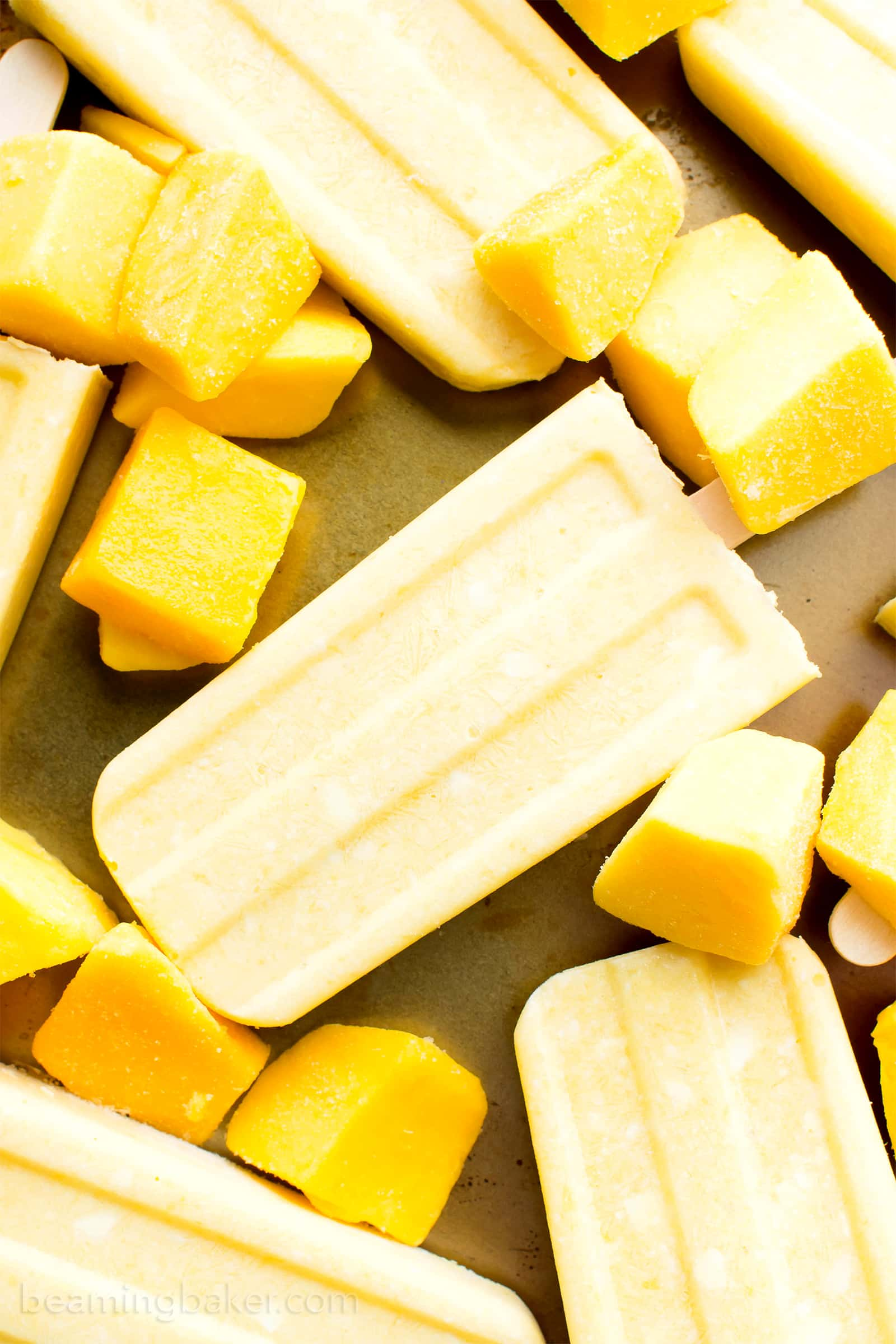 Mango Coconut Cream Popsicles (V, GF, DF): a 3 ingredient recipe for creamy and refreshing popsicles packed with mango and coconut! #Paleo #Vegan #DairyFree #GlutenFree | BeamingBaker.com