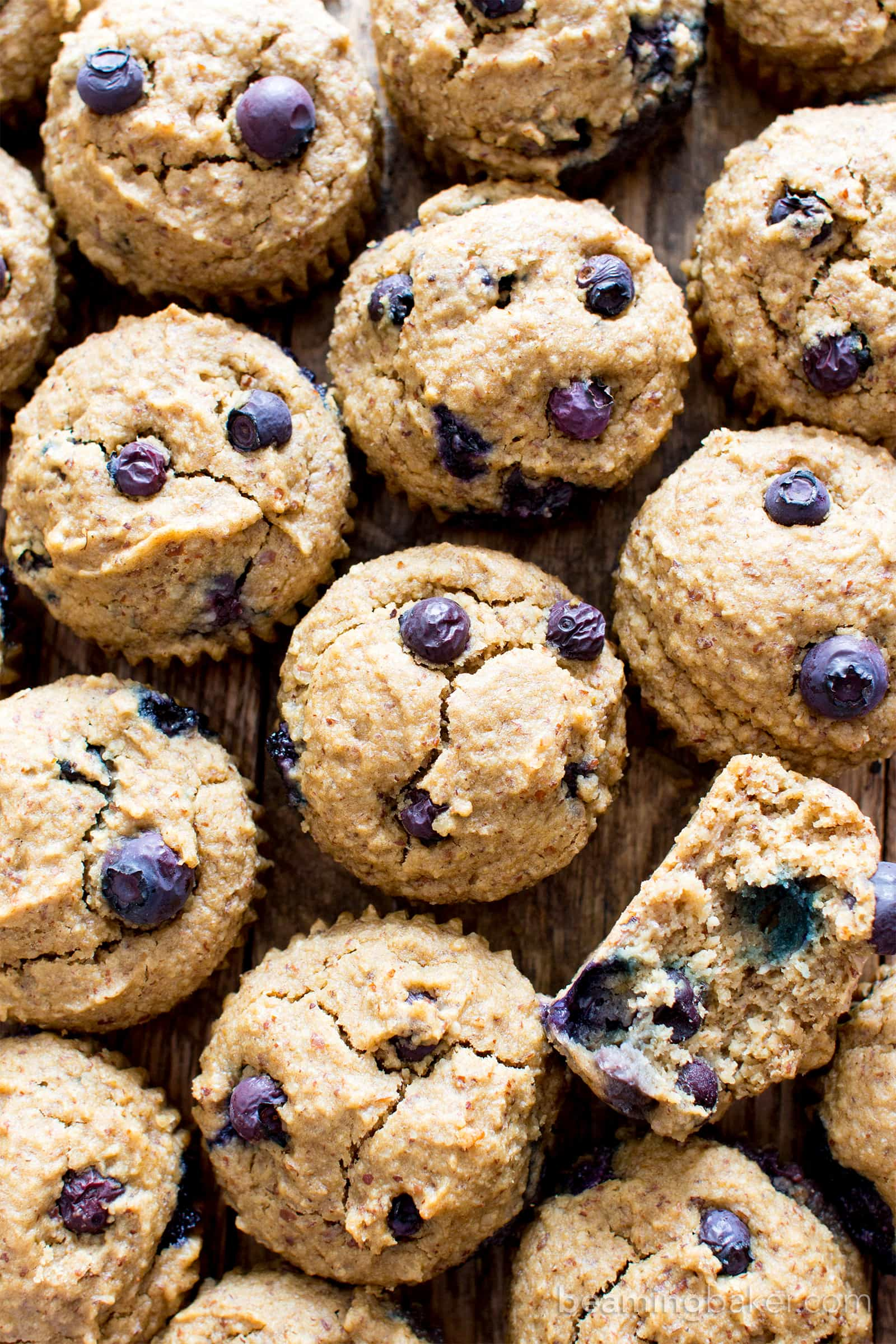 Gluten Free Vegan Blueberry Applesauce Muffins (V, GF): a one bowl recipe for soft & satisfying healthy blueberry muffins made with oat flour and applesauce. #Vegan #GlutenFree #WholeGrain #DairyFree #RefinedSugarFree | BeamingBaker.com