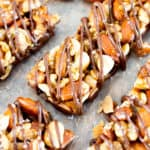 Homemade Dark Chocolate Sea Salt KIND Nut Bars (V, GF, DF): a protein-rich recipe for homemade KIND bars drizzled in dark chocolate and sprinkled with sea salt. #Vegan #GlutenFree #DairyFree #ProteinPacked | BeamingBaker.com
