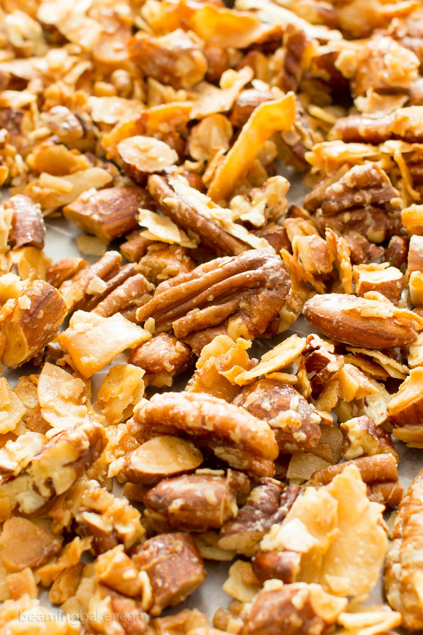 4 Ingredient Coconut Almond Pecan Paleo Granola (V, GF): a quick 'n easy recipe for crunchy, salty & sweet granola packed with whole ingredients. #Paleo #Vegan #Snacks #Healthy #GlutenFree #DairyFree #RefinedSugarFree | BeamingBaker.com