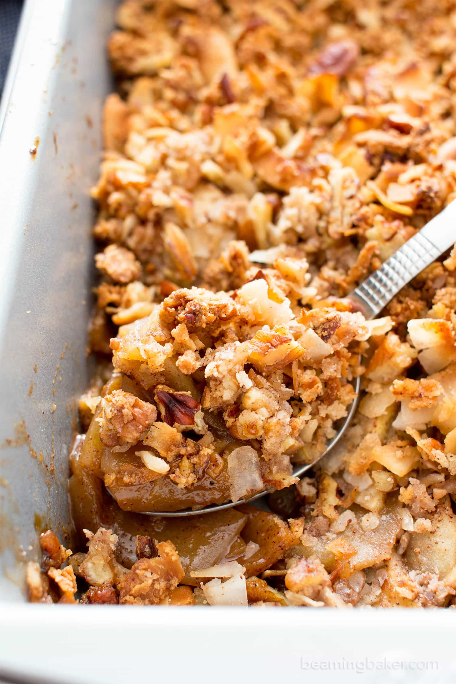 Paleo Apple Pecan Coconut Crisp Recipe (V, GF): a super crisp, nutty topping blanketing a warm, apple cinnamon filling with gooey caramelized coating. #Vegan #Paleo #GlutenFree #DairyFree #Healthy #Fall | BeamingBaker.com