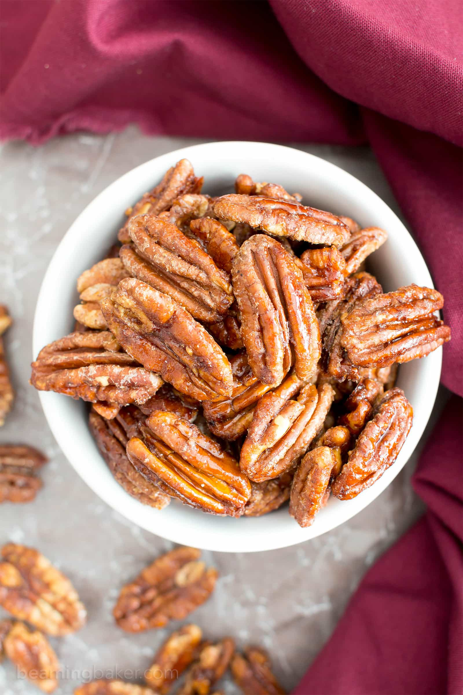 4 Ingredient Oven-Roasted Paleo Candied Pecans (V, GF): learn how to make deliciously glazed candied pecans with this easy, lower sugar recipe. #Paleo #Vegan #Christmas #HolidayRecipes #GlutenFree #DairyFree | Recipe on BeamingBaker.com