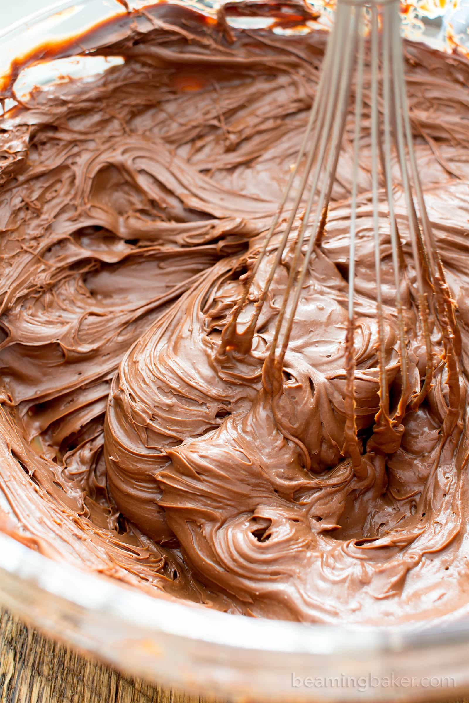 How to Make Homemade Chocolate Frosting Recipe (V, GF): learn how to make easy vegan chocolate frosting that's smooth, silky and chocolatey. Whipped frosting doesn't require refrigeration! #Vegan #Paleo #HealthyDesserts #DairyFree #GlutenFree | Recipe on BeamingBaker.com