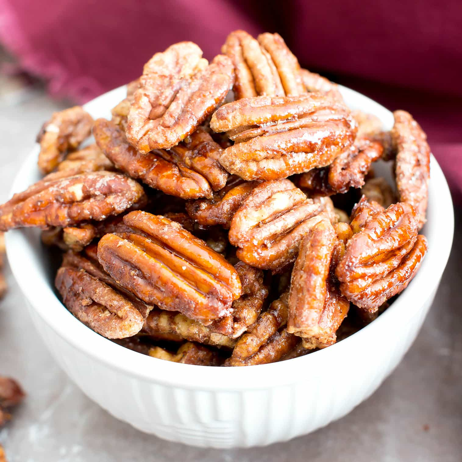 Vegan Candied Pecans: learn how to make candied pecans with just 4 healthy ingredients! Prep time is just 5 mins for deliciously glazed candied pecans in this lower sugar recipe! #Pecans #Healthy #Vegan #Fall | Recipe at BeamingBaker.com