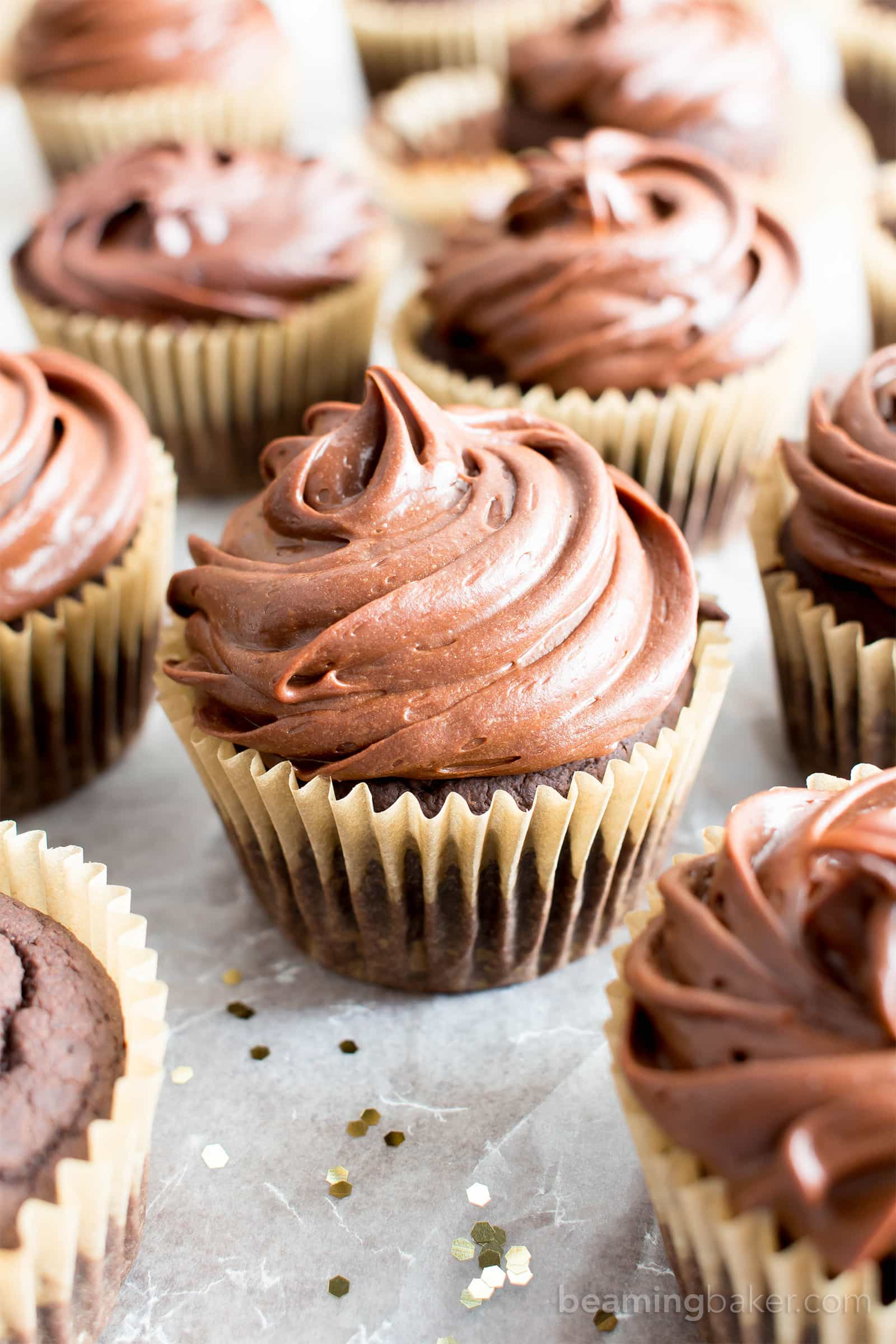 Vegan Gluten Free Chocolate Cupcakes (V, GF): an easy recipe for deliciously moist chocolate cupcakes topped with silky smooth chocolate frosting. #Vegan #GlutenFree #DairyFree #Dessert #Cupcakes | Recipe on BeamingBaker.com