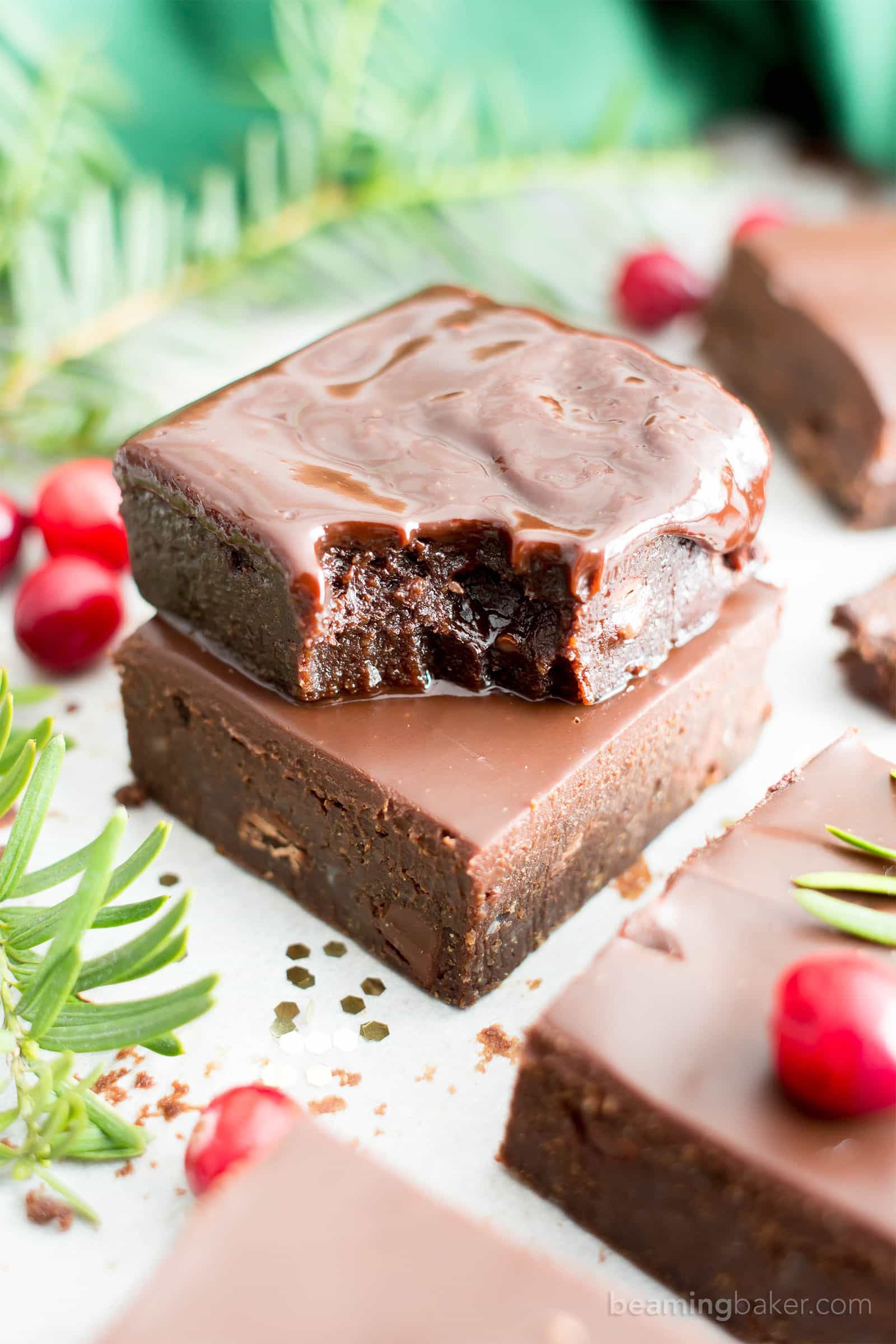 Moist & Fudgy Ganache Peppermint Brownies Recipe (V, GF): an easy recipe for indulgently fudgy, cool mint brownies topped with silky smooth chocolate ganache made with healthy ingredients. #Vegan #GlutenFree #DairyFree #HealthyHolidayDesserts #Desserts | Recipe on BeamingBaker.com