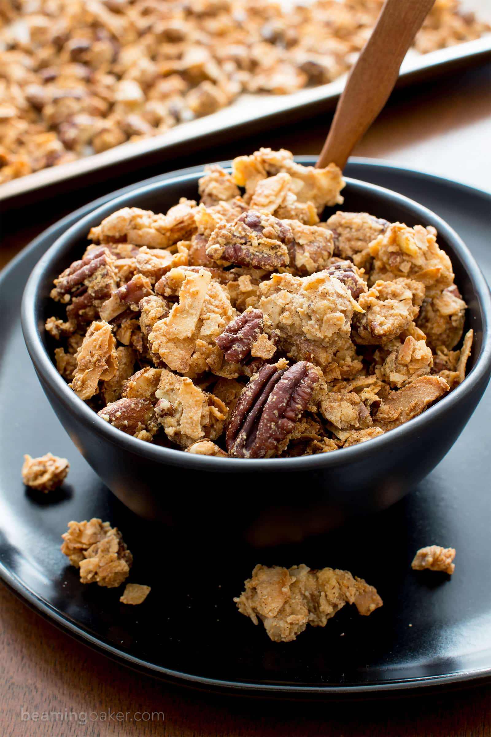 Homemade Chunky Paleo Granola with Clusters (V, GF): a warm, cozy recipe for grain-free homemade granola packed with crunchy nuts and satisfyingly sweet clusters. #Paleo #Vegan #GlutenFree #DairyFree #Granola #Snacks | Recipe on BeamingBaker.com