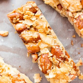 3 Ingredient Homemade KIND Coconut Almond Bar Recipe (V, GF): an easy recipe for homemade paleo KIND bars packed with crunchy almonds and sweet coconut. #Paleo #Vegan #GlutenFree #DairyFree #Healthy #Snacks | Recipe on BeamingBaker.com