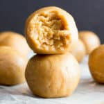 No Bake Peanut Butter Balls: just 3 ingredients for the best peanut butter bites—no bake, easy to make, simple & healthy ingredients. Soft and delicious no bake peanut butter balls. Vegan. #NoBake #PeanutButter #NoBakeBalls #NoBakeBites   Recipe at BeamingBaker.com