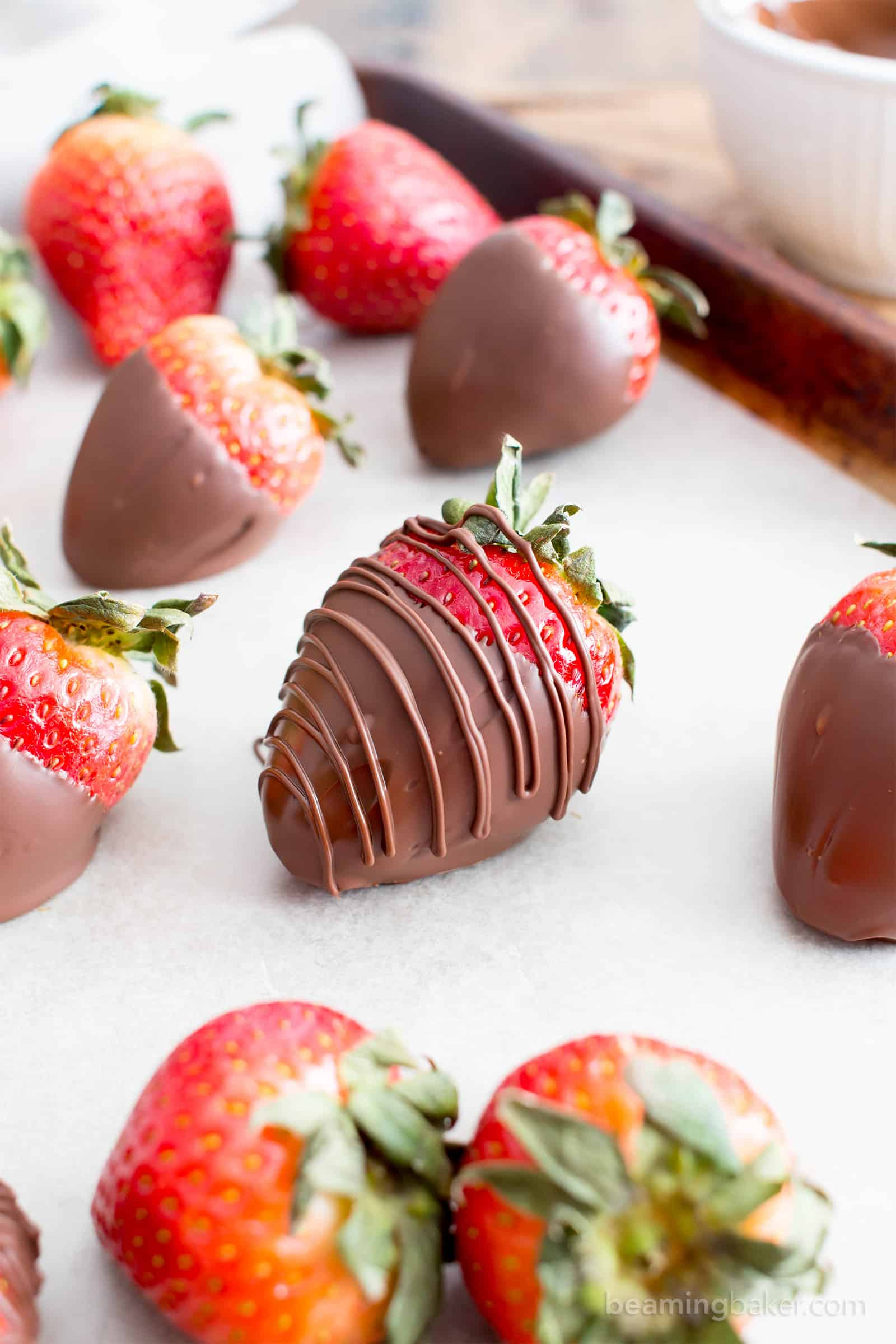 How to Make Chocolate Dipped Strawberries Recipe (V, GF): learn how easy it is to make beautiful, decadently delicious chocolate dipped strawberries! #Vegan #GlutenFree #DairyFree #Paleo #ValentinesDay #Dessert | Recipe on BeamingBaker.com