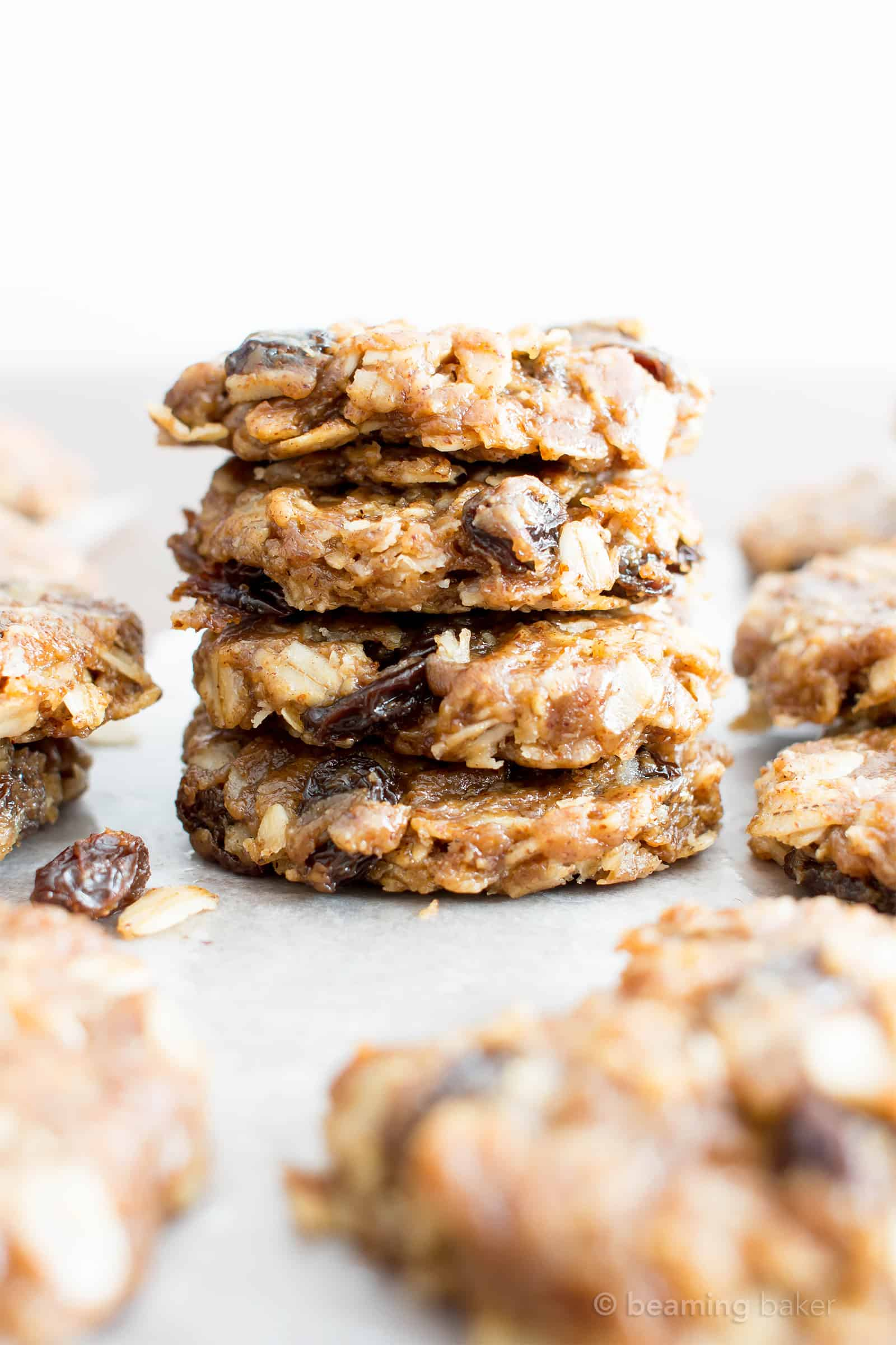 4 Ingredient No Bake Chewy Oatmeal Raisin Cookies (V, GF): an easy recipe for delightfully chewy no bake cookies bursting with raisins and cinnamon flavor! #Vegan #GlutenFree #DairyFree #Cookies #NoBake #Dessert | Recipe on BeamingBaker.com