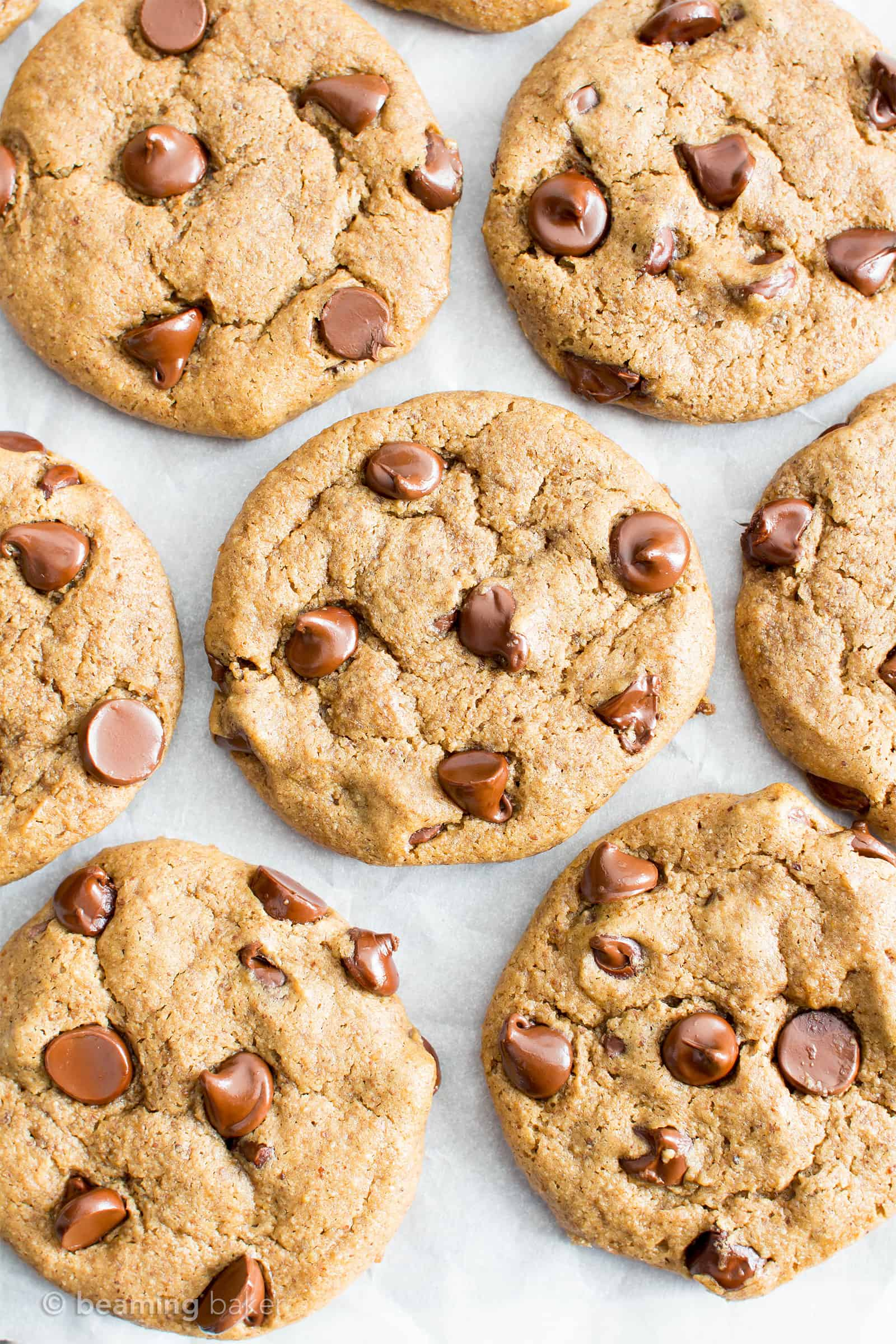 Gluten Free Almond Butter Chocolate Chip Cookies (V, GF): an irresistible recipe for perfectly chewy chocolate chip cookies made with smooth, creamy almond butter and a secret ingredient. #Vegan #GlutenFree #DairyFree #Cookies #Dessert #AD | Recipe on BeamingBaker.com