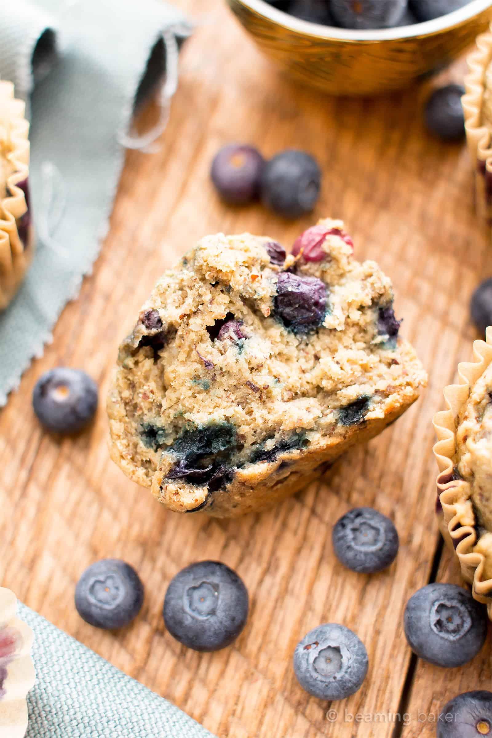 Healthy Banana Blueberry Muffins Recipe (V, GF): an easy recipe for moist banana muffins bursting with fresh blueberry flavor! #Vegan #GlutenFree #DairyFree #Breakfast #Healthy   Recipe on BeamingBaker.com
