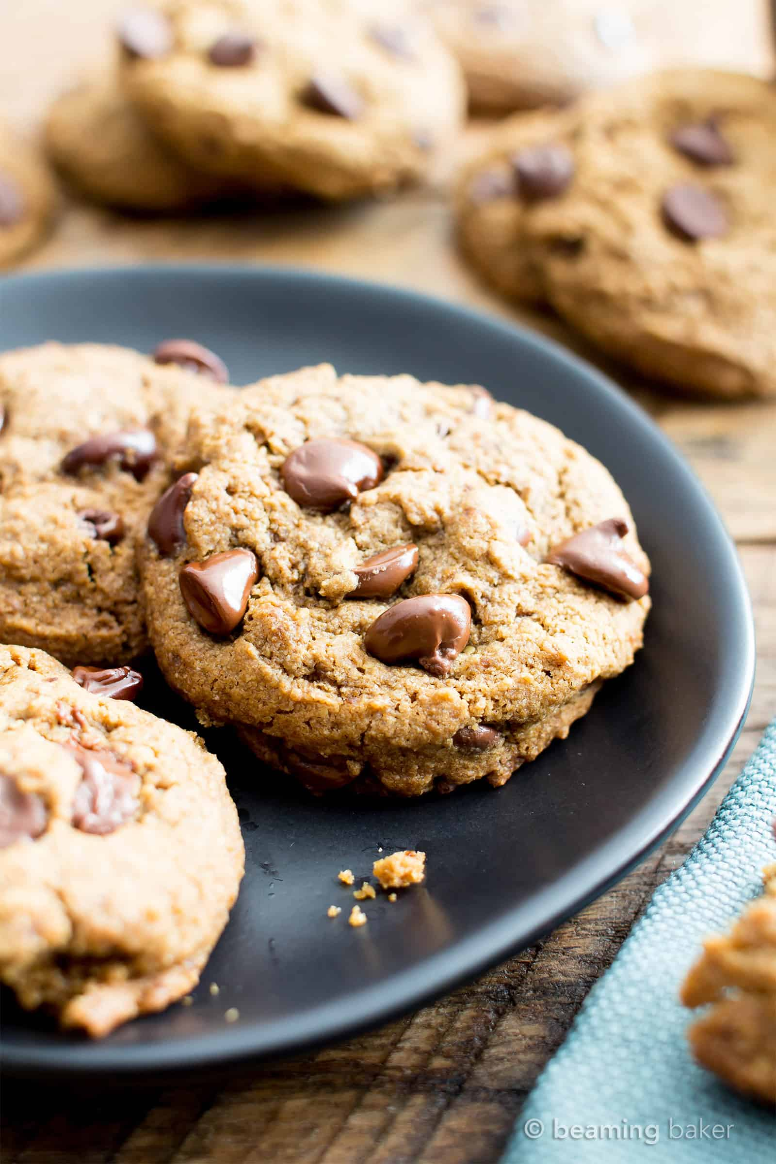 Vegan Chocolate Chip Cookies Recipe (V, GF): Chewy on the inside, crispy on the edges, and packed with rich chocolate. My favorite chocolate chip cookies! #Vegan #GlutenFree #DairyFree #Cookies #Dessert | Recipe on BeamingBaker.com