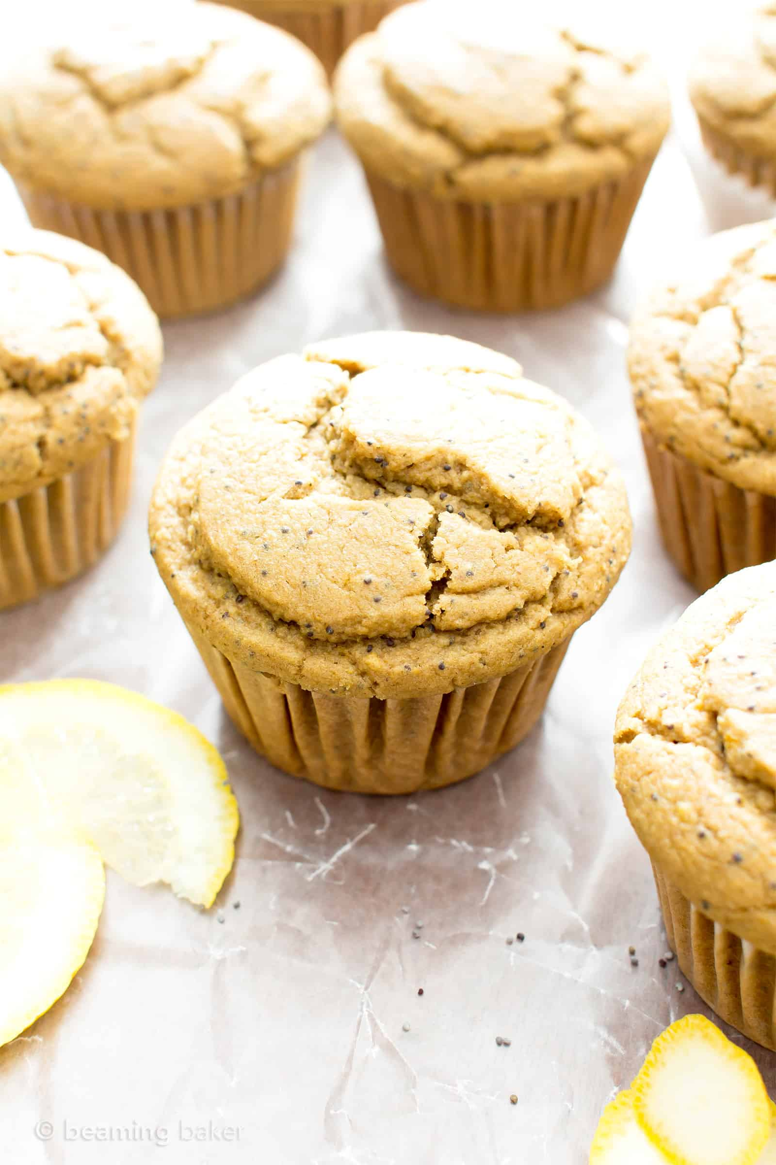 Healthy Lemon Poppy Seed Muffins Recipe (V, GF): wonderfully moist and fluffy muffins bursting with poppy seeds and lemon flavor. The perfect balance of sweet and tart! #Vegan #GlutenFree #DairyFree #Breakfast #Snacks | Recipe on BeamingBaker.com