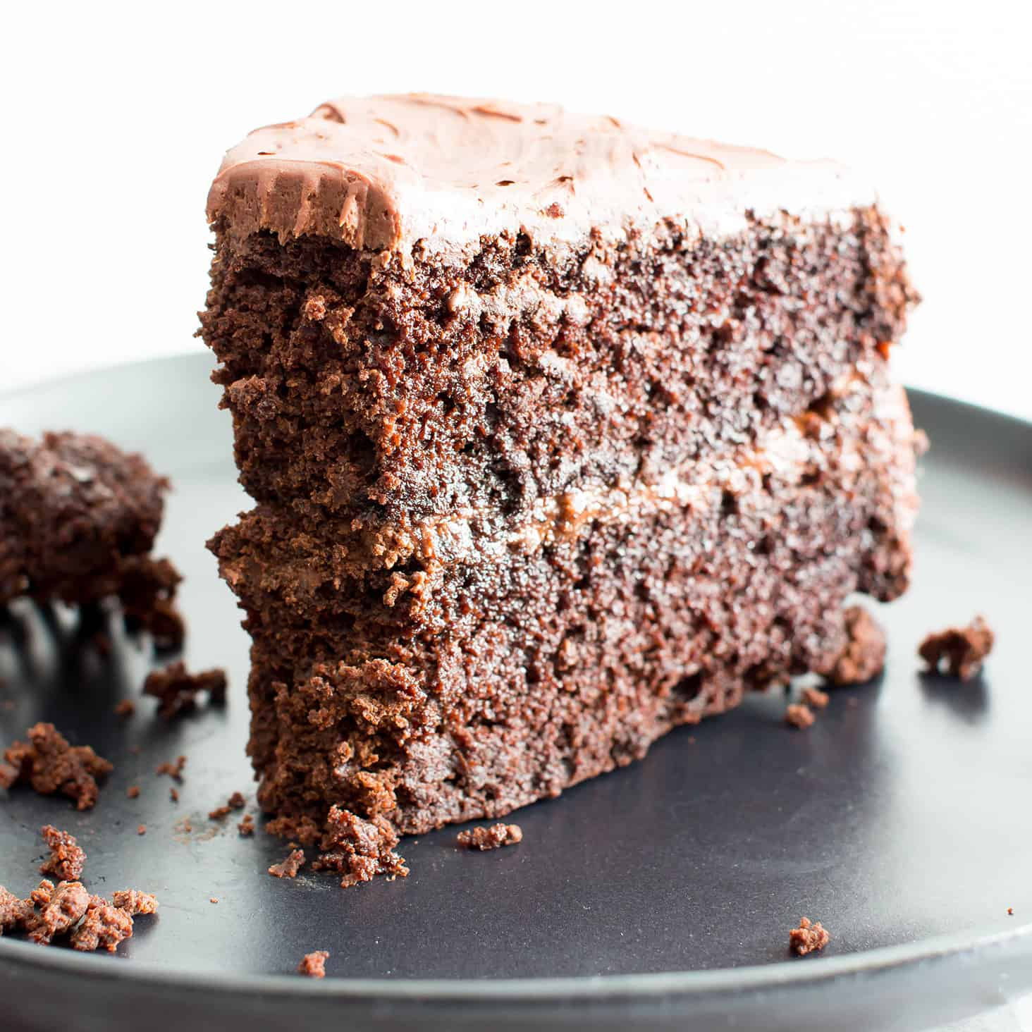 Vegan Chocolate Cake Recipe (V, GF): an easy recipe for supremely rich, perfectly moist chocolate cake covered in a delicious layer of irresistible chocolate frosting! #Vegan #GlutenFree #DairyFree #Chocolate #Cake #Dessert | Recipe on BeamingBaker.com