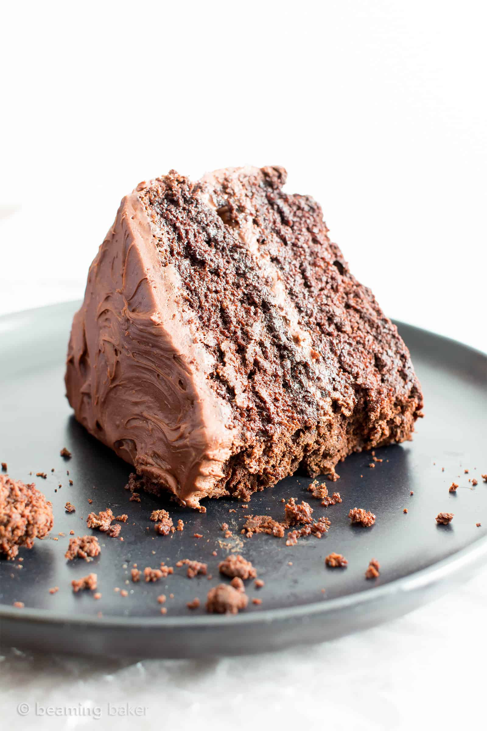 Vegan Chocolate Cake Recipe (V, GF): an easy recipe for supremely rich, perfectly moist chocolate cake that covered in a thick layer of irresistible chocolate frosting! #Vegan #GlutenFree #DairyFree #Chocolate #Cake #Dessert | Recipe on BeamingBaker.com