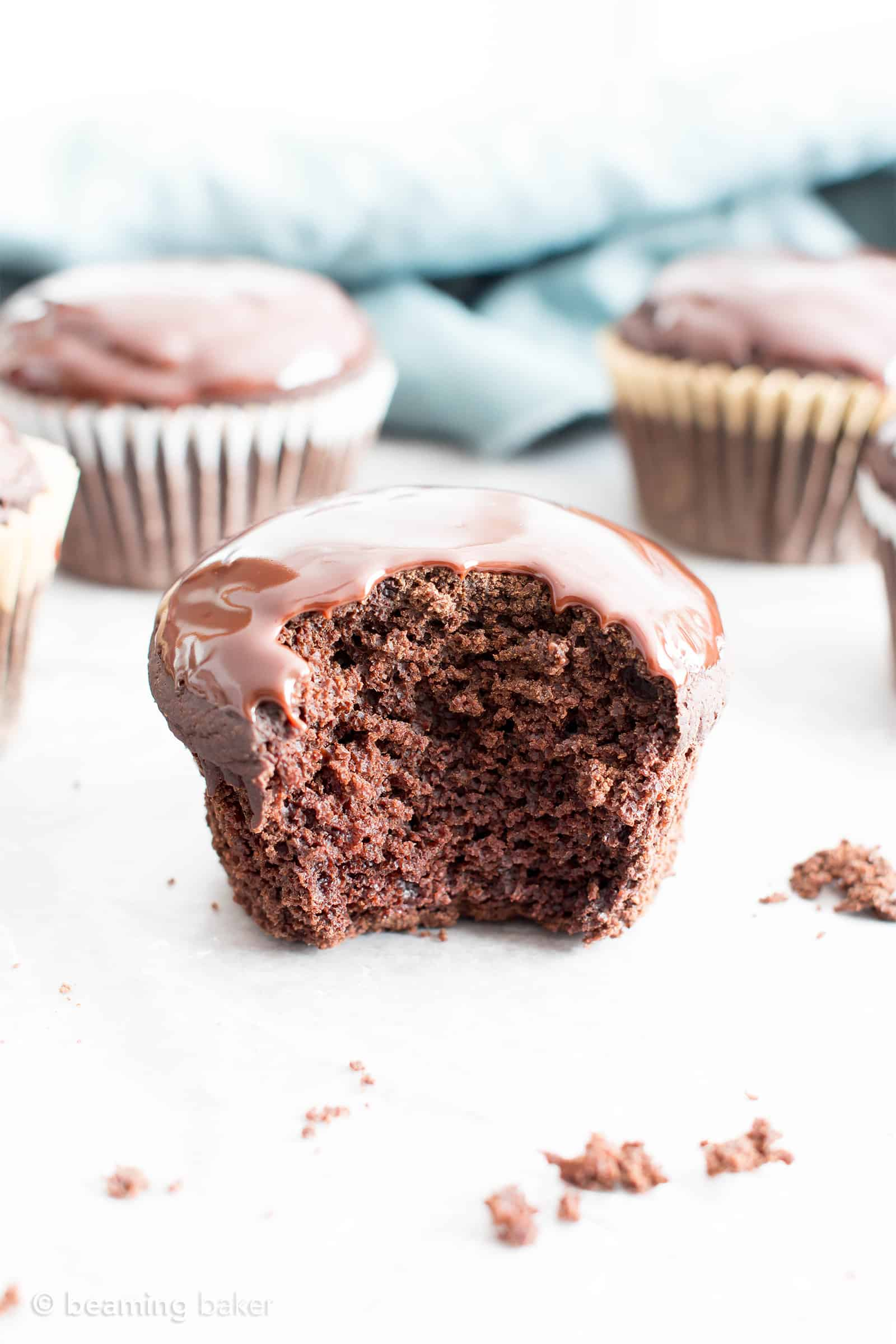 Chocolate Ganache Cupcakes (V, GF): an easy recipe for perfectly moist chocolate cupcakes covered in a thick layer of rich chocolate ganache! #Vegan #GlutenFree #DairyFree #Chocolate #Dessert   Recipe on BeamingBaker.com