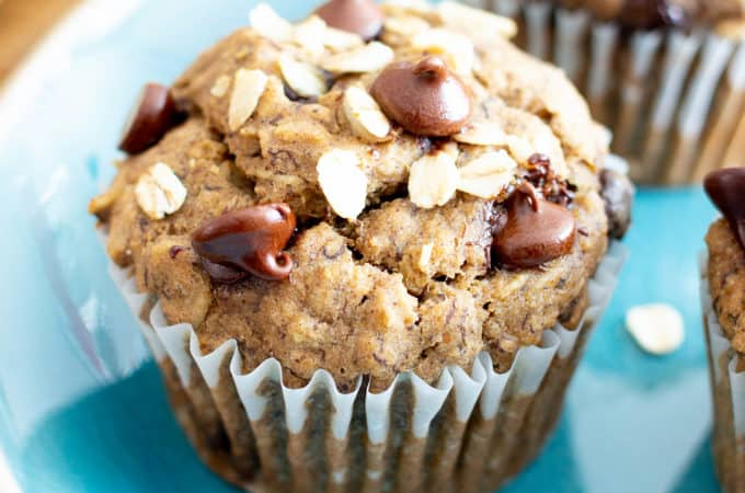 Banana Oatmeal Chocolate Chip Muffins (V, GF): a healthy 1-bowl recipe for moist, satisfying fresh-baked banana muffins bursting with hearty oats and decadent chocolate chips. #Bananas #Vegan #GlutenFree #Muffins #Healthy #Oats | Recipe at BeamingBaker.com