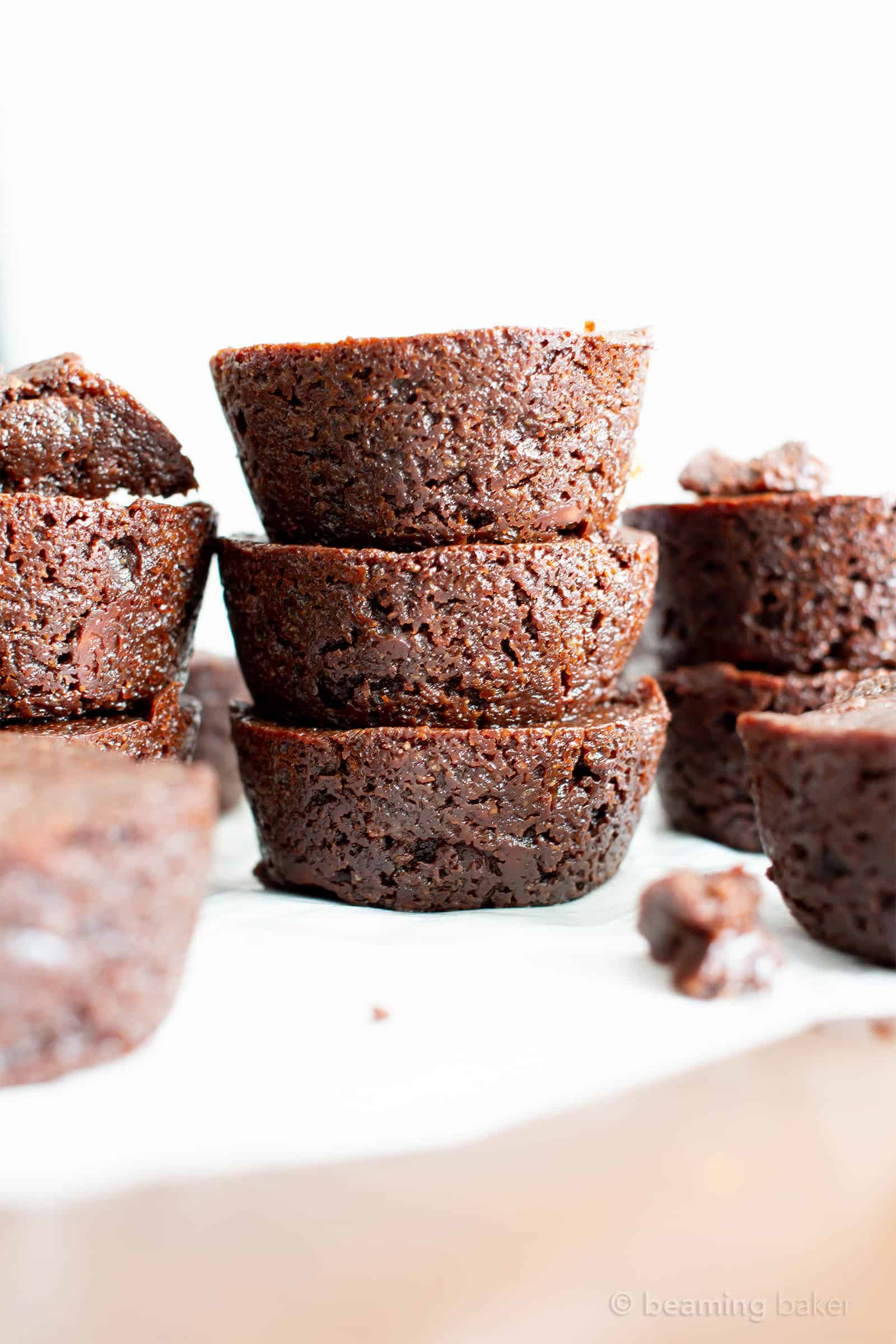 Mini Vegan Brownie Bites Recipe (V, GF): an easy recipe for soft, fudgy 'n moist two bite mini brownies bursting with rich, chocolate flavor. Made with healthy, whole ingredients. #Vegan #GlutenFree #DairyFree #Brownies #VeganBaking #Chocolate | Recipe at BeamingBaker.com