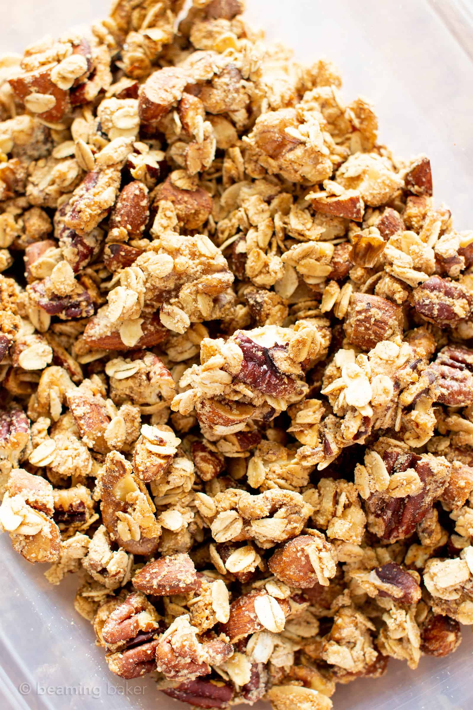 4 Ingredient Healthy Homemade Gluten Free Vegan Granola Recipe (V, GF): a crispy homemade granola recipe made in just a few minutes of prep time, packed full of your favorite nuts and oats. #Vegan #Granola #GlutenFree #Healthy #Snacks | Recipe at BeamingBaker.com