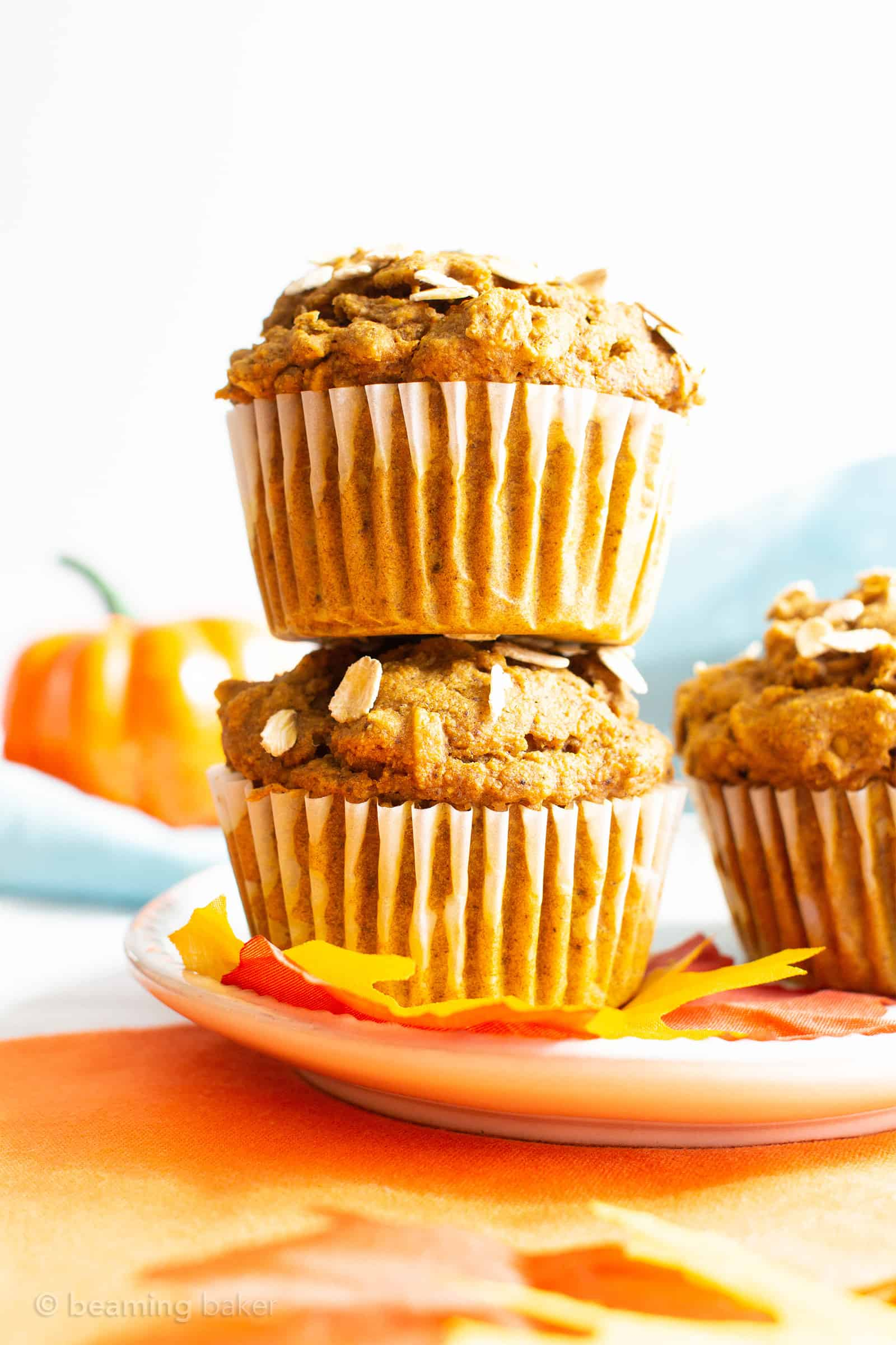 Healthy Pumpkin Oatmeal Muffins (V, GF): a one bowl recipe for lightly sweet and perfectly moist pumpkin muffins packed with healthy, whole ingredients. #Vegan #GlutenFree #DairyFree #GlutenFreeVegan #Pumpkin #Breakfast | Recipe on https://beamingbaker.com